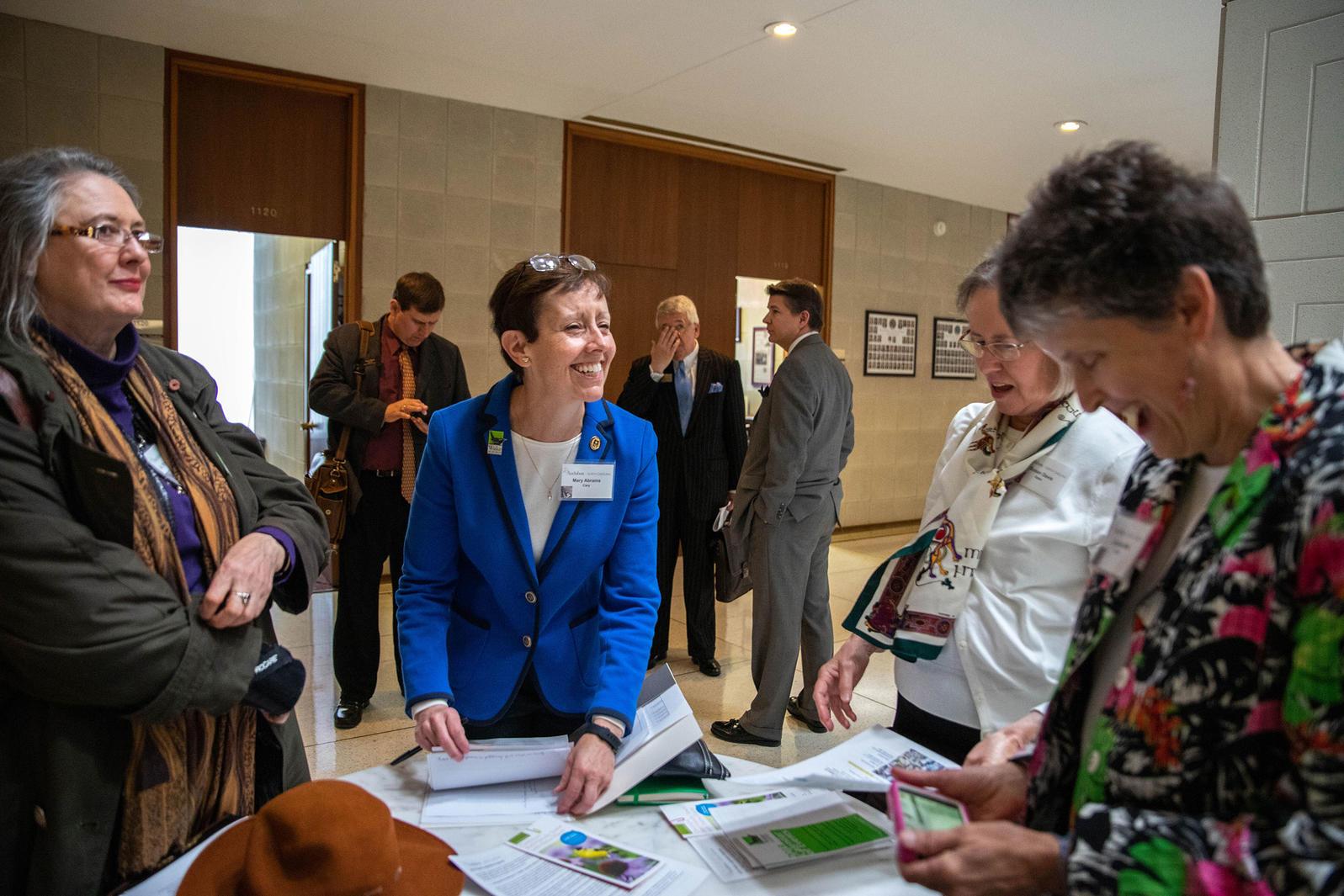 Mary Abrams, Audubon ambassador and member of Wake Audubon, debriefs her fellow constituents prior to meeting their new senator, Wiley Nickel. Dominic Arenas/Audubon