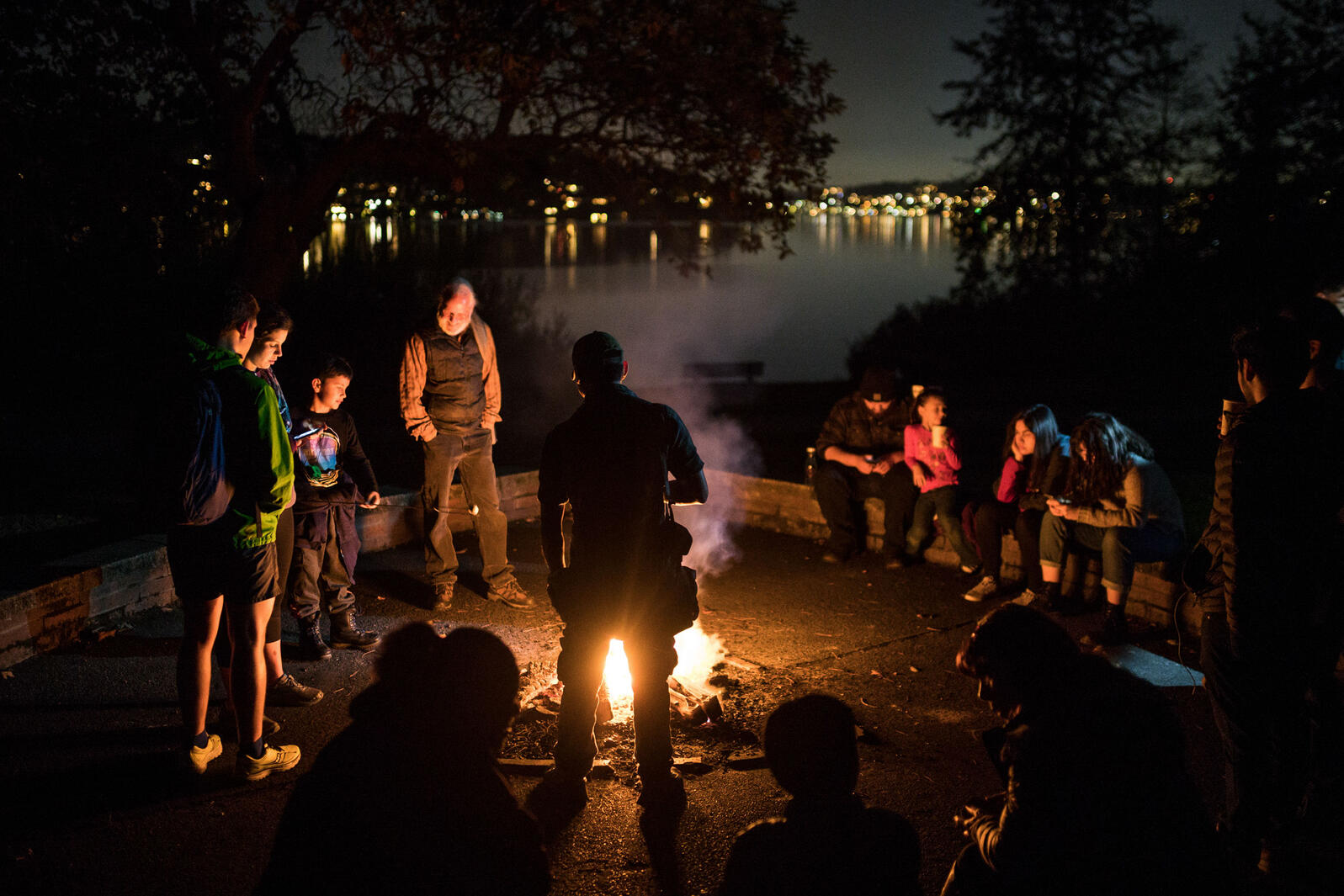 As a part of National Hispanic Heritage Month, participants young and old enjoy a campfire as an Owl Prowl winds down at Seward Park Audubon Center in Seattle, Wash. in October of 2018. Grant Hindsley