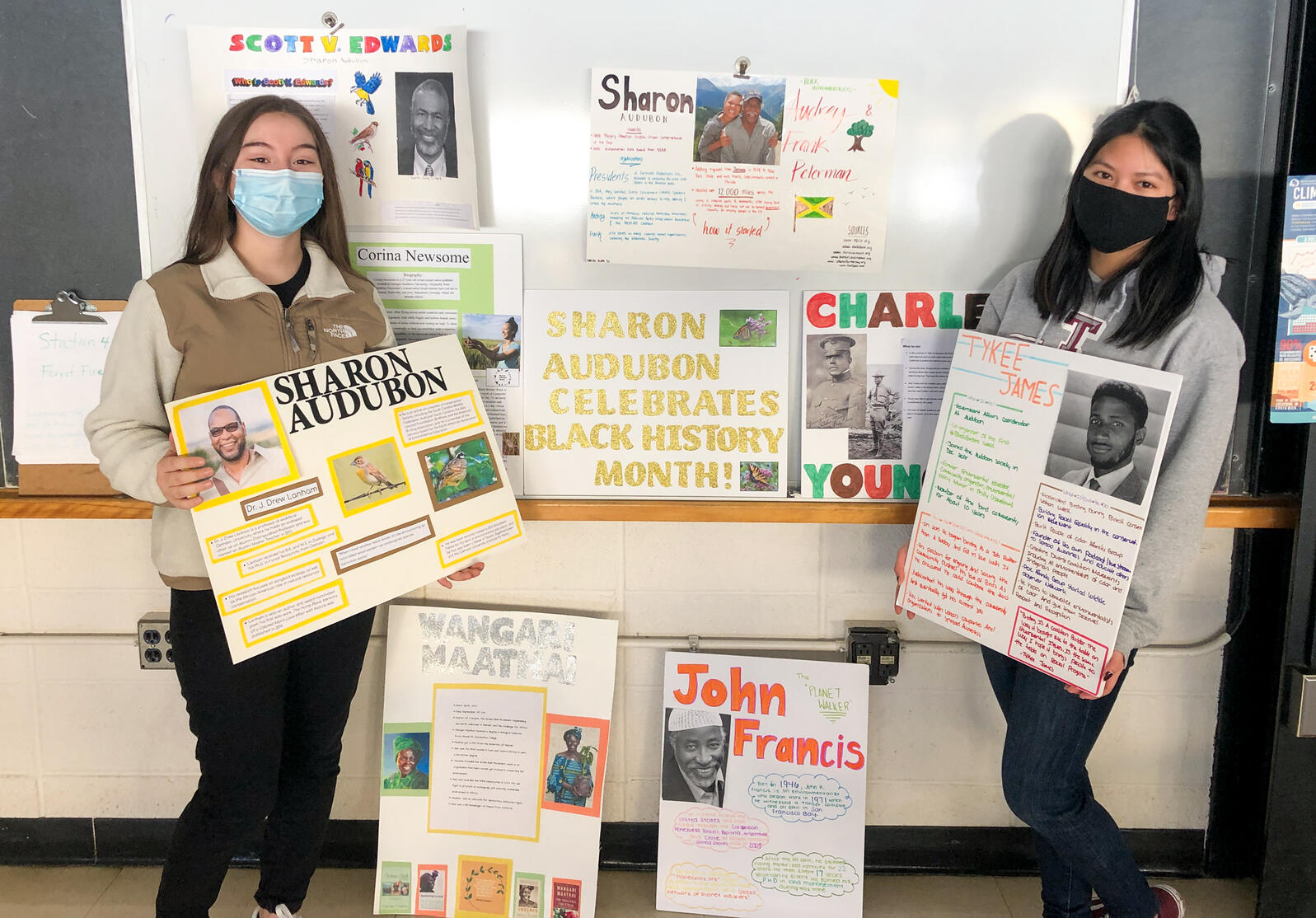 Torrington High School Science Club President Emma Dasilva Martinez, left, and Vice President Jianna Calcinari hold up posters they've made to celebrate Black History Month. Courtesy of Torrington High School Science Club