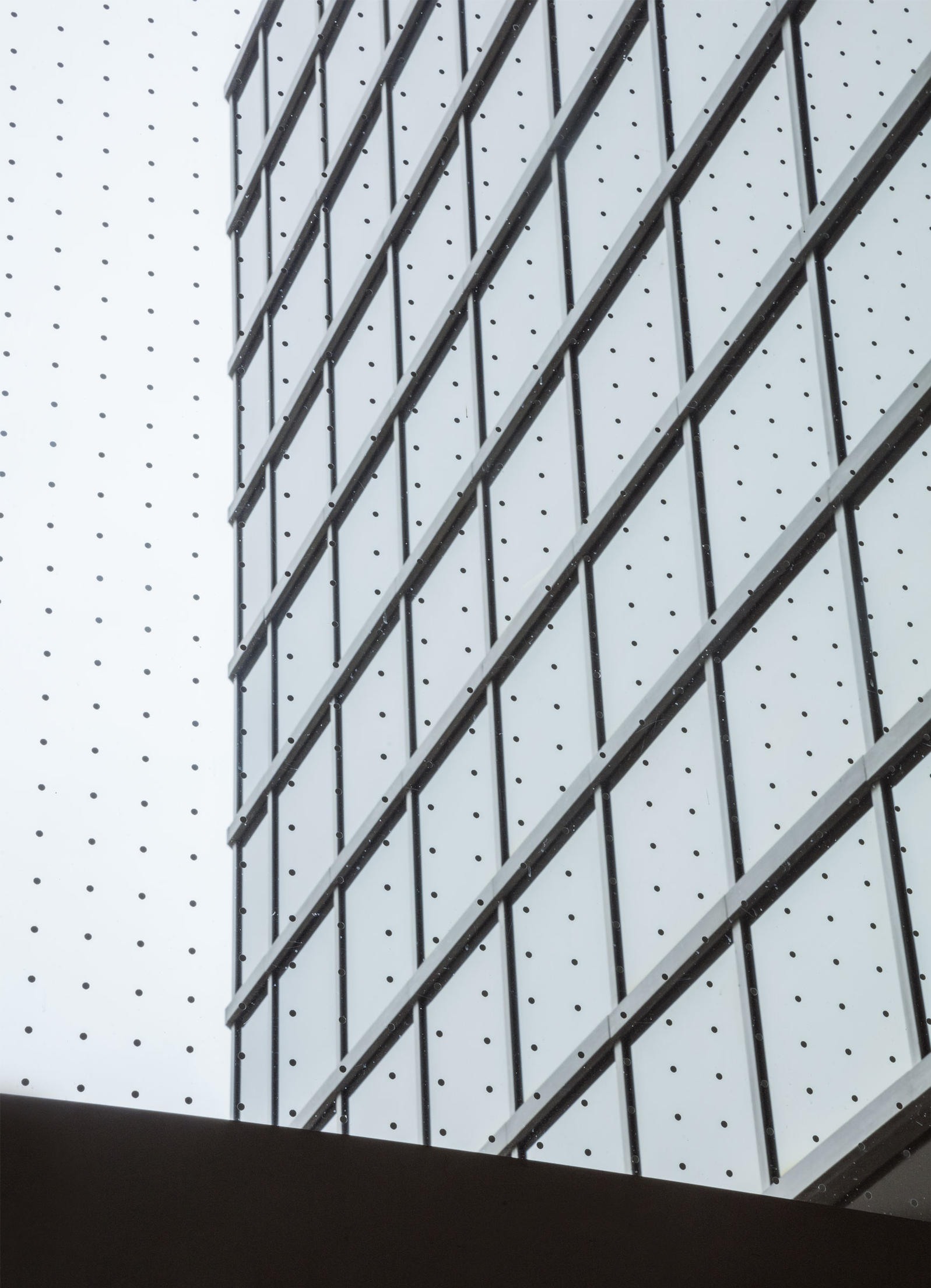 Looking out from inside this 13-story building in Toronto, the grid of dots installed to reduce collisions is noticeable but doesn't impede the view. Patterned glass was applied only to the eastern façade, which faces a park. Richard Barnes