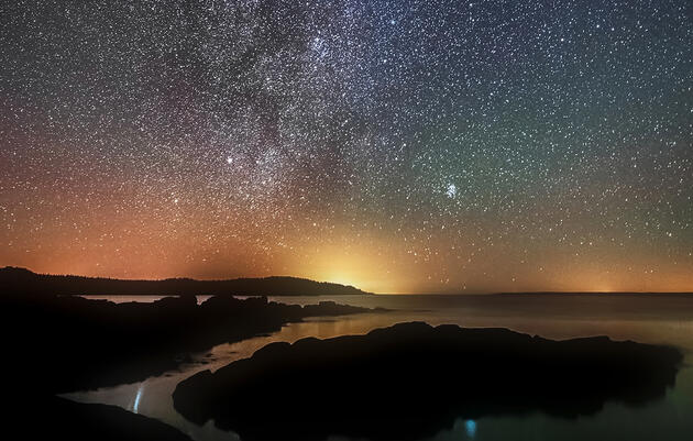 Light pollution from Grand Manan Island and other developed areas in the Northeast competes with the grandeur of the Milky Way, as seen from the Bog Brook Preserve area on Maine's Bold Coast. Mike Taylor