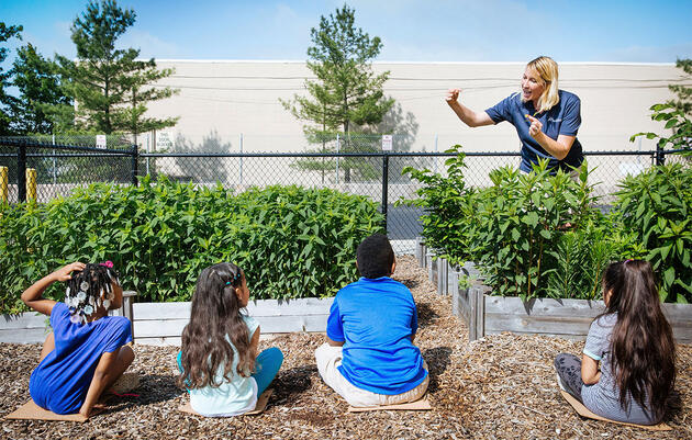 Barron gives a lesson on native plants and birds to students at Whitehall Elementary School in May. The plant beds seen here were built by Audubon and are maintained by Whitehall Elementary students. Rachel Wisniewski