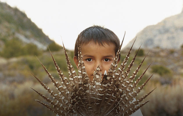 Andrew_Geiger_Time_to_Act. A young resident of Wyoming's Wind River reservation holds Sage-Grouse tail feathers. Andrew Geiger