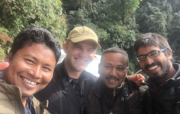 Binanda, Noah, Bidyut, and Ramit smile after spotting a Yellow-rumped Honeyguide for No. 6,000. Noah Strycker