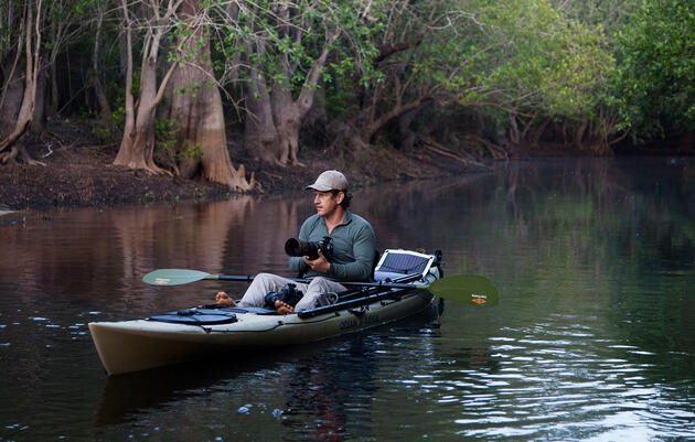 Photographer Carlton Ward Jr. in the Okefenokee Swamp. By using a boat, you're likely to see, and shoot, birds in an entirely new way. Kayaks can usually handle rougher water than canoes, though in open boats can carry more gear. Mac Stone