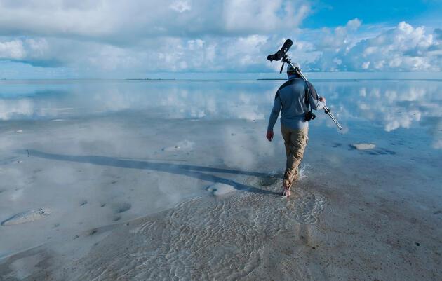 Audubon's Matt Jeffery treks across the flats after a shorebird survey at the Bahamas' new Joulter Cays National Park. Walker Golder/Audubon
