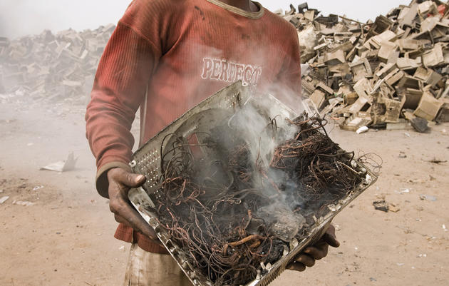 Aging computers are often shipped from Europe and America to poor regions of the world, such as Ghana. There the computer wires are burned and stripped to recover copper and other metals, which are then resold in China or India. Peter Essick