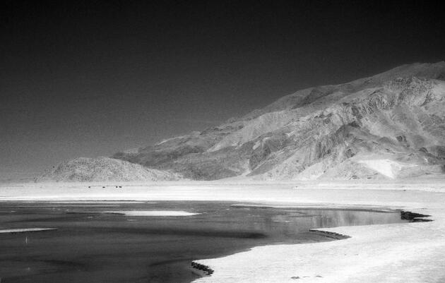 Owens Lake, at the base of the Inyo Mountains, covers nearly 100 square miles. The lakebed is crisscrossed by a grid of driveable dikes that hide hundreds of miles of pipeline. Photograph by Rosalie Winard