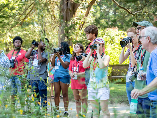 """Attendees at the """"Birds in Focus"""" portion of the Strawberry Plains Hummingbird Festival test out Canon gear. Holly Springs, Mississippi. Dominic Arenas/Audubon"""
