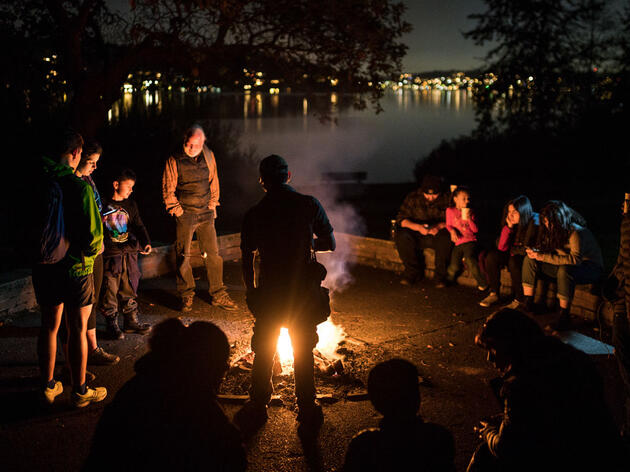 As a part of National Hispanic Heritage Month participants young and old enjoy a campfire as Owl Prowl winds down at Seward Park Audubon Center in Seattle, Wash. in October of 2018. Grant Hindsley