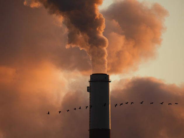 The Clean Power Plan requires states to cut carbon emissions from power plants, such as this coal-fired plant in Kansas. Charlie Riedel/AP
