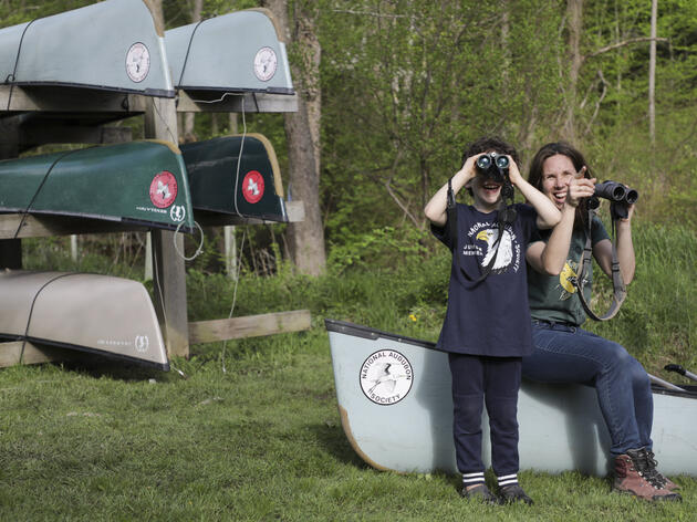 A woman and child birding together