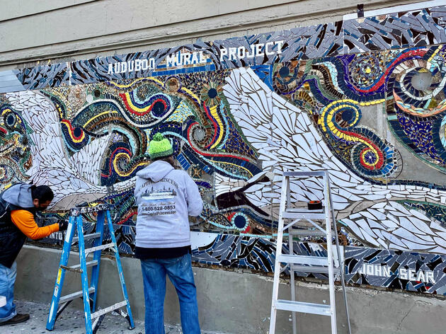 Artist Carlos Pinto (left) installing the mosaic with help from a volunteer. Mike Fernandez/Audubon
