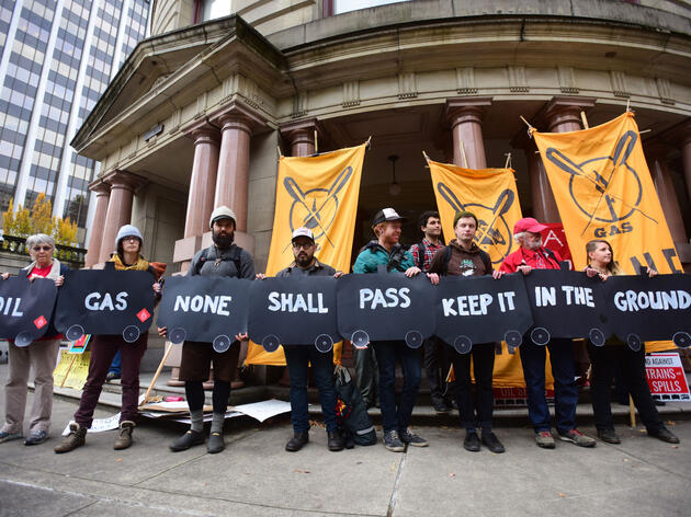 Protesters gather outside of Portland's City Hall on November 4, 2015, showing support for a City Council vote to oppose fossil fuel transport through the city. Alex Milan Tracy/Sipa/AP