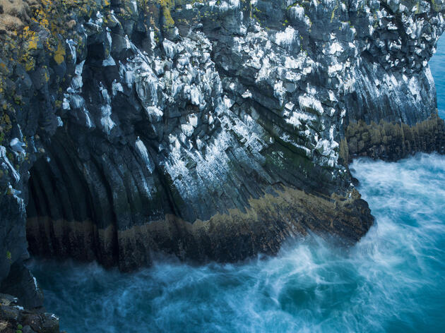 Kittiwake guano streaks a cliffside in western Iceland. Harmful chemicals have been showing up in the excrement of several species of seabirds. David Noton Photography/Alamy