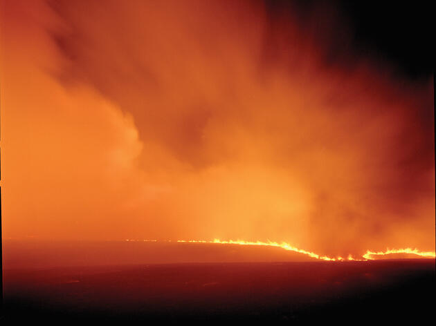 A wall of fire crests a hill along Bloody Creek Road in Chase County, Kansas. Larry Schwarm