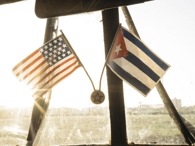 A U.S. flag paired with a Cuban flag hangs on the windshield of the car that took Tim Gallagher and Martjan Lammertink to Guantanamo. Greg Kahn