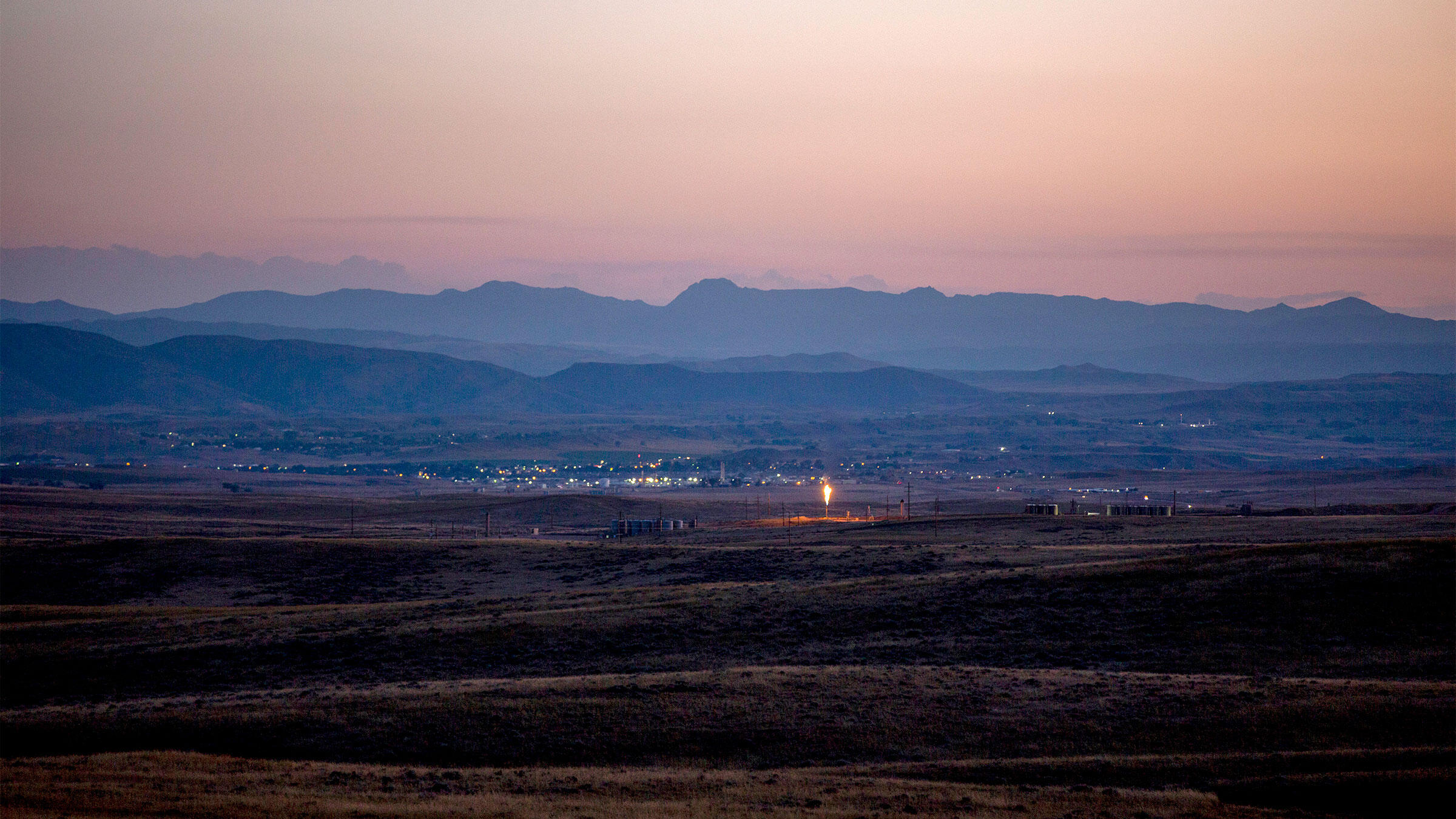 Natural gas flare at an oil drilling site in Wyoming. Kristina Barker/The New York Times
