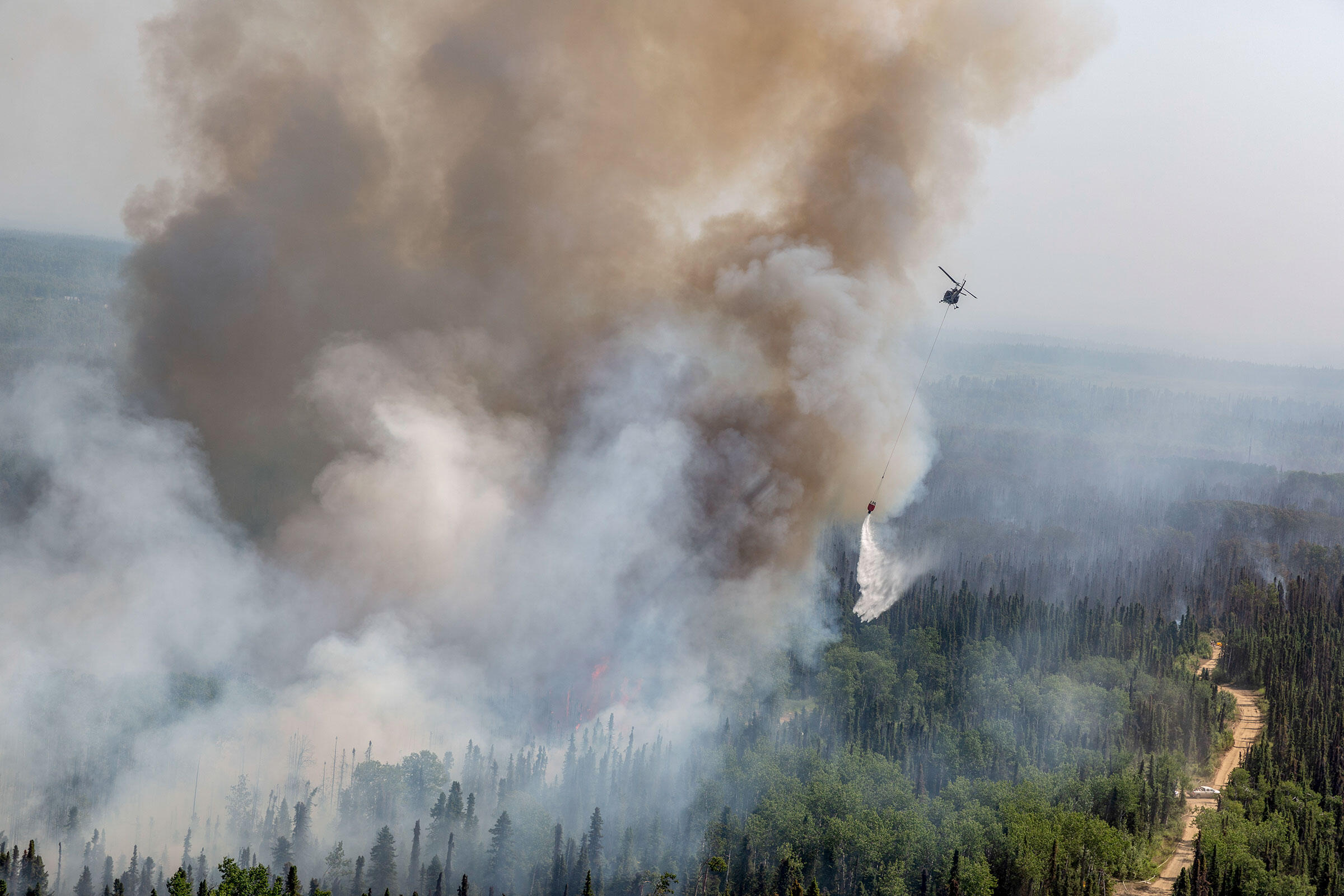 Alaska Army National Guard and Department of Forestry crews fight a wildfire near Talkeetna, Alaska. July 2019. Spc. Michael Risinger/U.S. Army National Guard