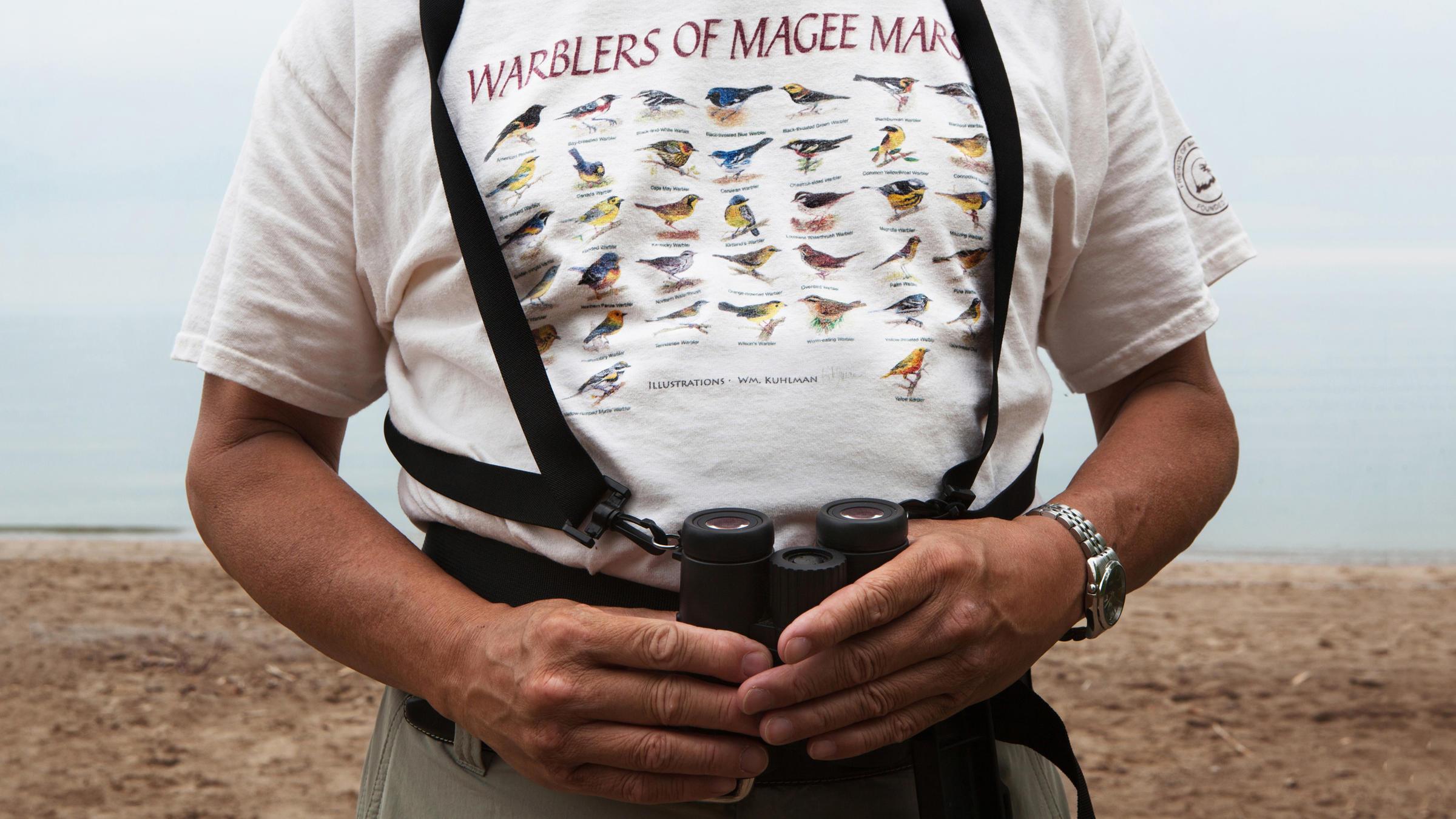 A recurrent festivalgoer sports a vintage Biggest Week shirt. Camilla Cerea/Audubon