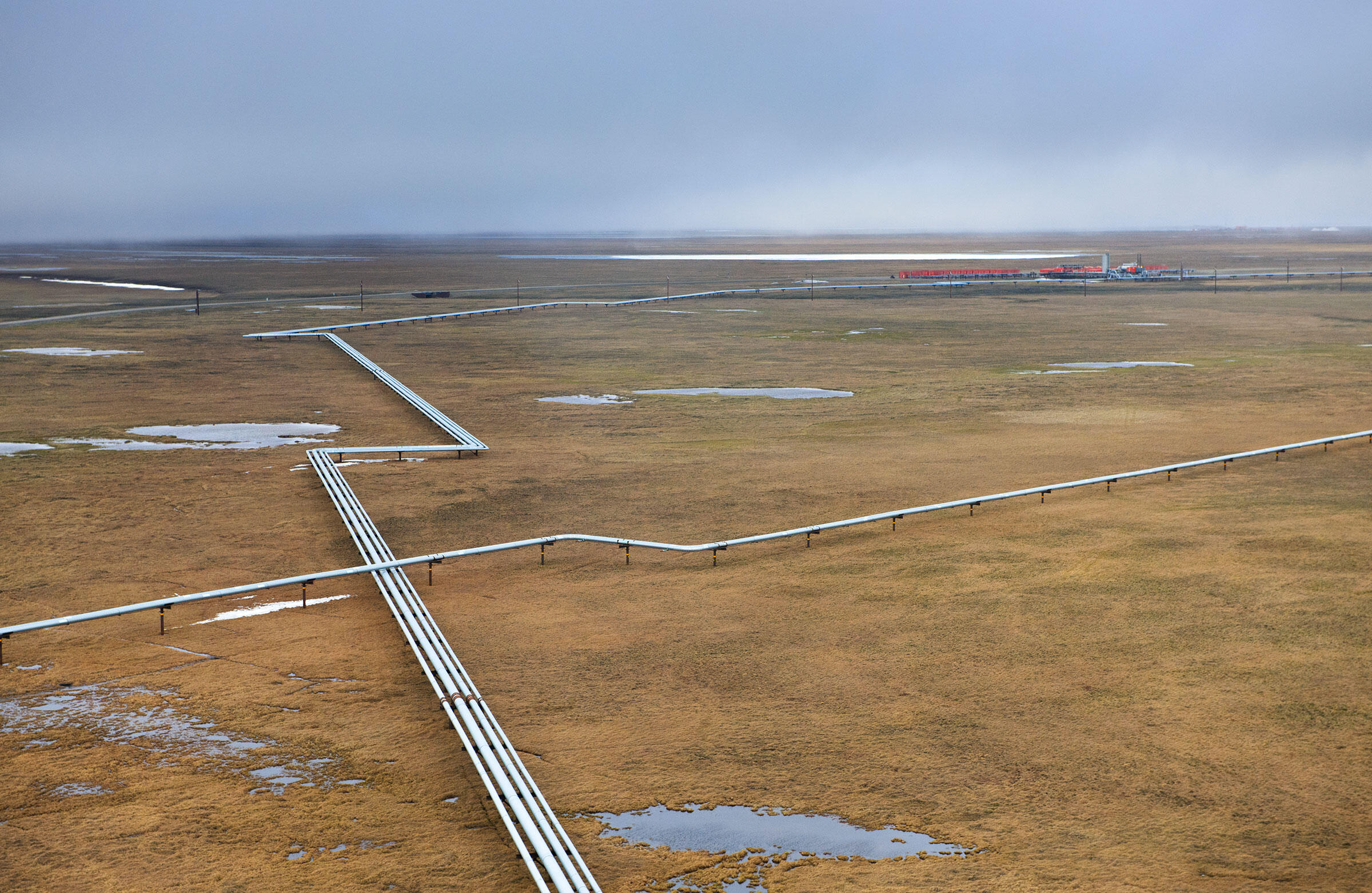 The Prudhoe Bay oilfield, the largest oil field in North America, reaches over 100 miles between its western edge and the Arctic Refuge. A large network of roads and pipelines crisscrosses the coastal tundra. Florian Schulz
