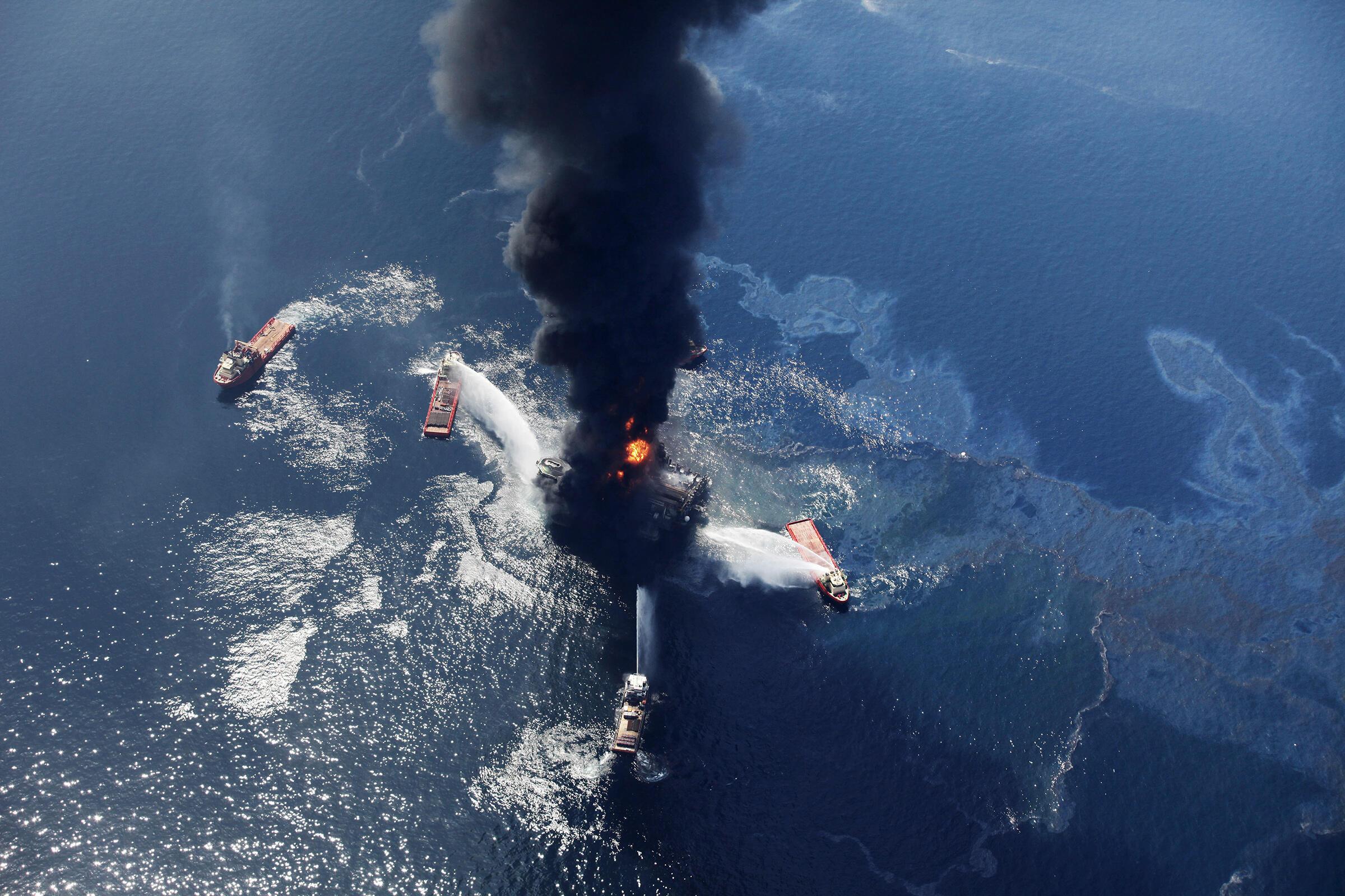 The oil slick burning on Wednesday, April 21, 2010, seen next to the Deepwater Horizon oil rig. Gerald Herbert/AP
