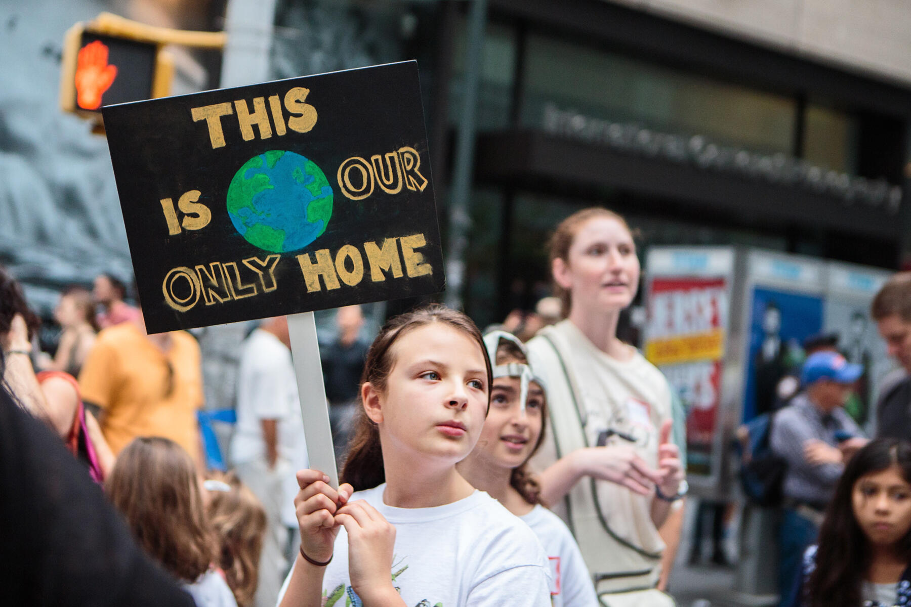 An Audubon member holds a sign at the People's Climate March in NYC in 2014. Patricia Monteiro