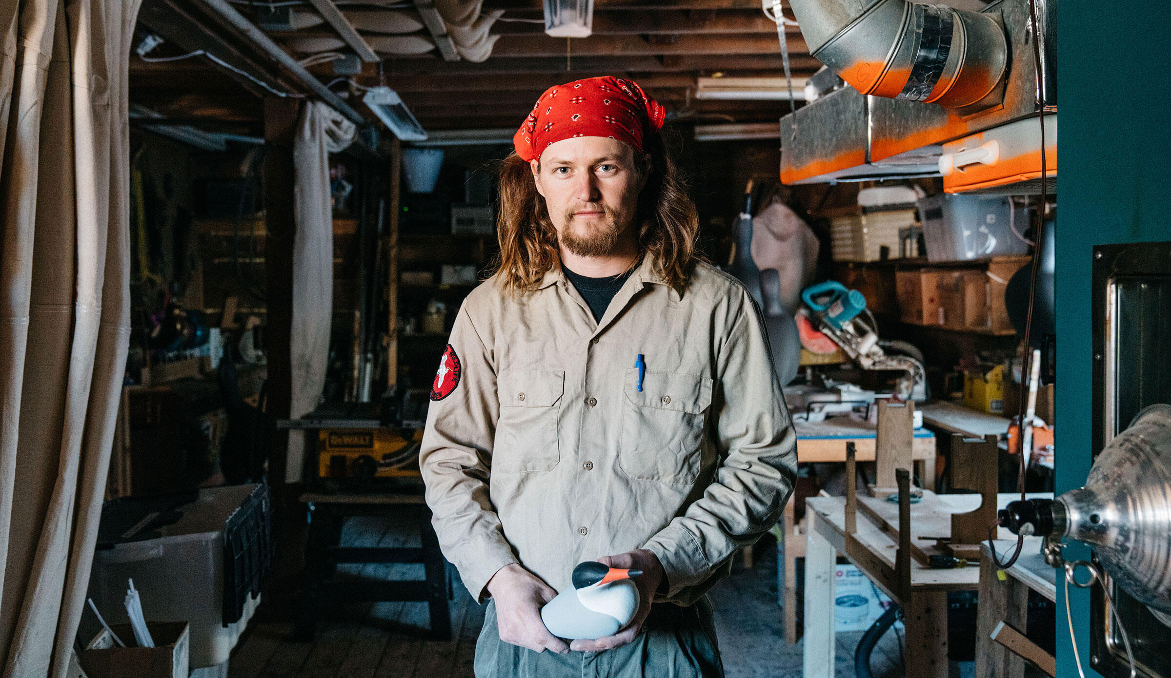 Eric Snyder, decoy production manager, in the National Audubon Society's production barn up the hill from the dock to Hog Island Audubon Camp in Bremen, Maine. Tristan Spinski