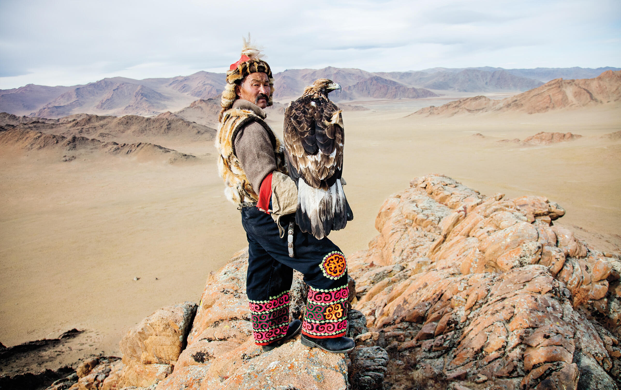 Dalaikhan Itale wears traditional Kazakh garb out on the hunt with his Golden Eagle in western Mongolia. Cedric Angeles/Intersection Photos