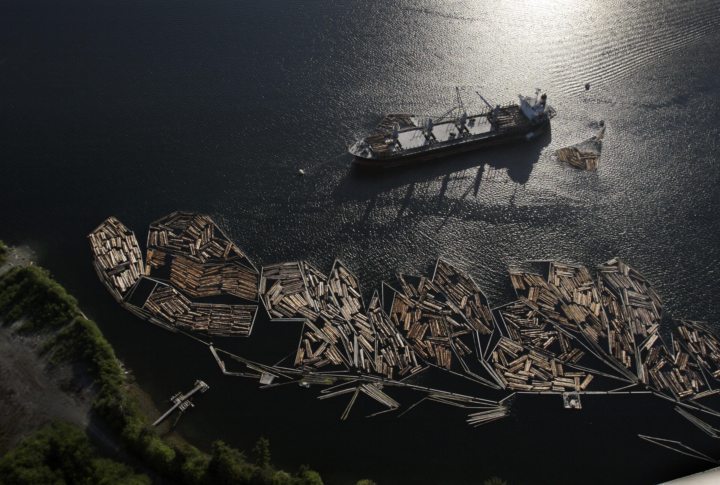 Timber is loaded for export onto a ship in Thorne Bay, Prince Wales Island, Alaska. Melissa Farlow/National Geographic Creative