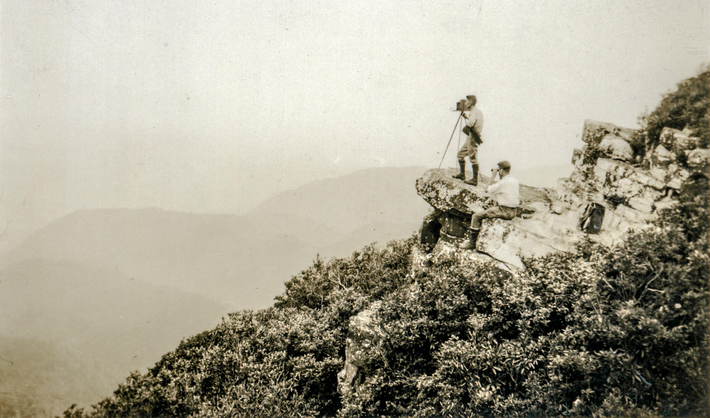 George Masa using a view camera on Graybeard Mountain, North Carolina, 1920s-30s. North Carolina Collection, Pack Memorial Public Library