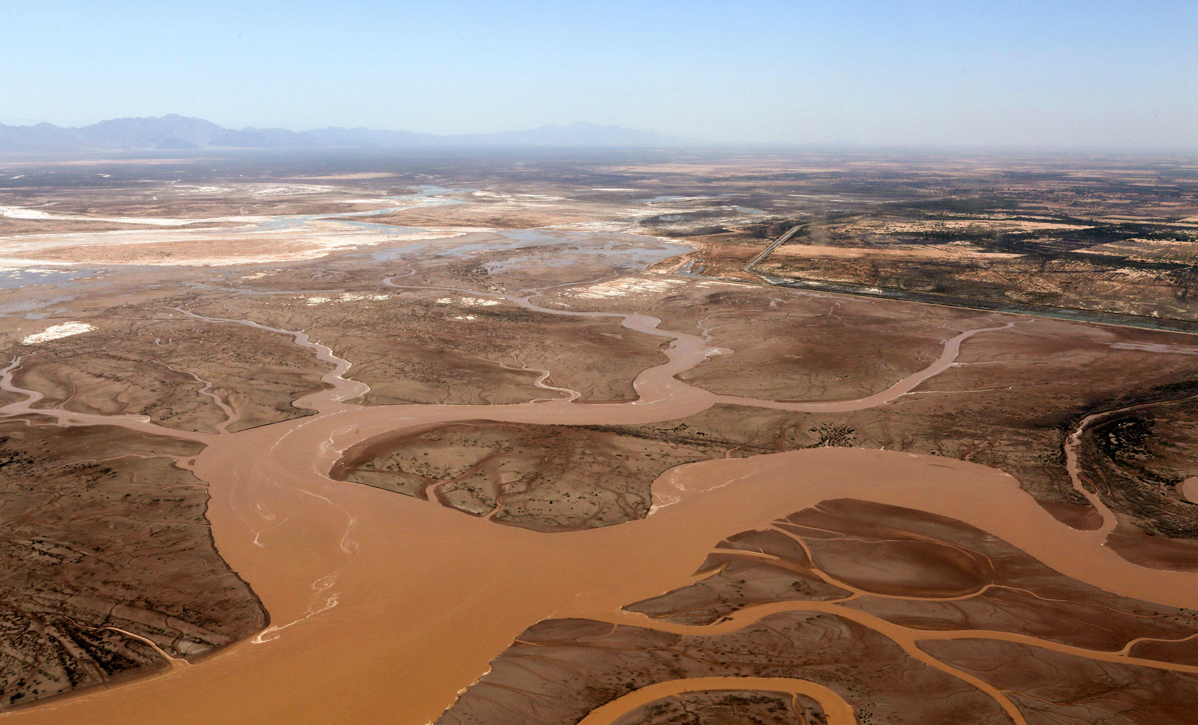 """The Colorado River near where it meets the Gulf of California, after a 2014 """"pulse flow."""" Francisco Zamora/Sonoran Institute, with aerial support from LightHawk/USGS"""