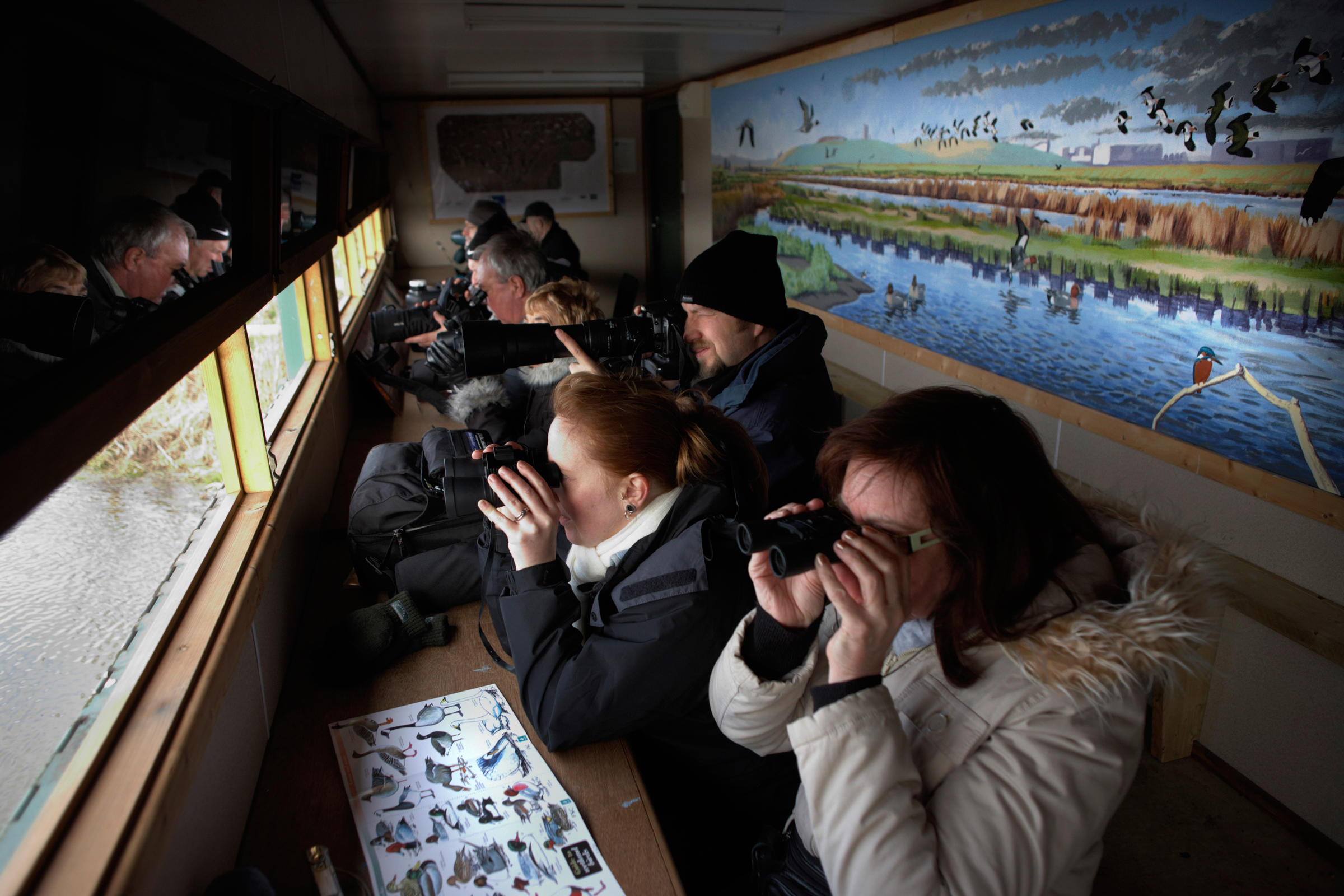 In a blind at a Royal Society for Protection of Birds (RSPB) reserve at Rainham Marshes, Essex. England. Richard Baker/In Pictures/Corbis