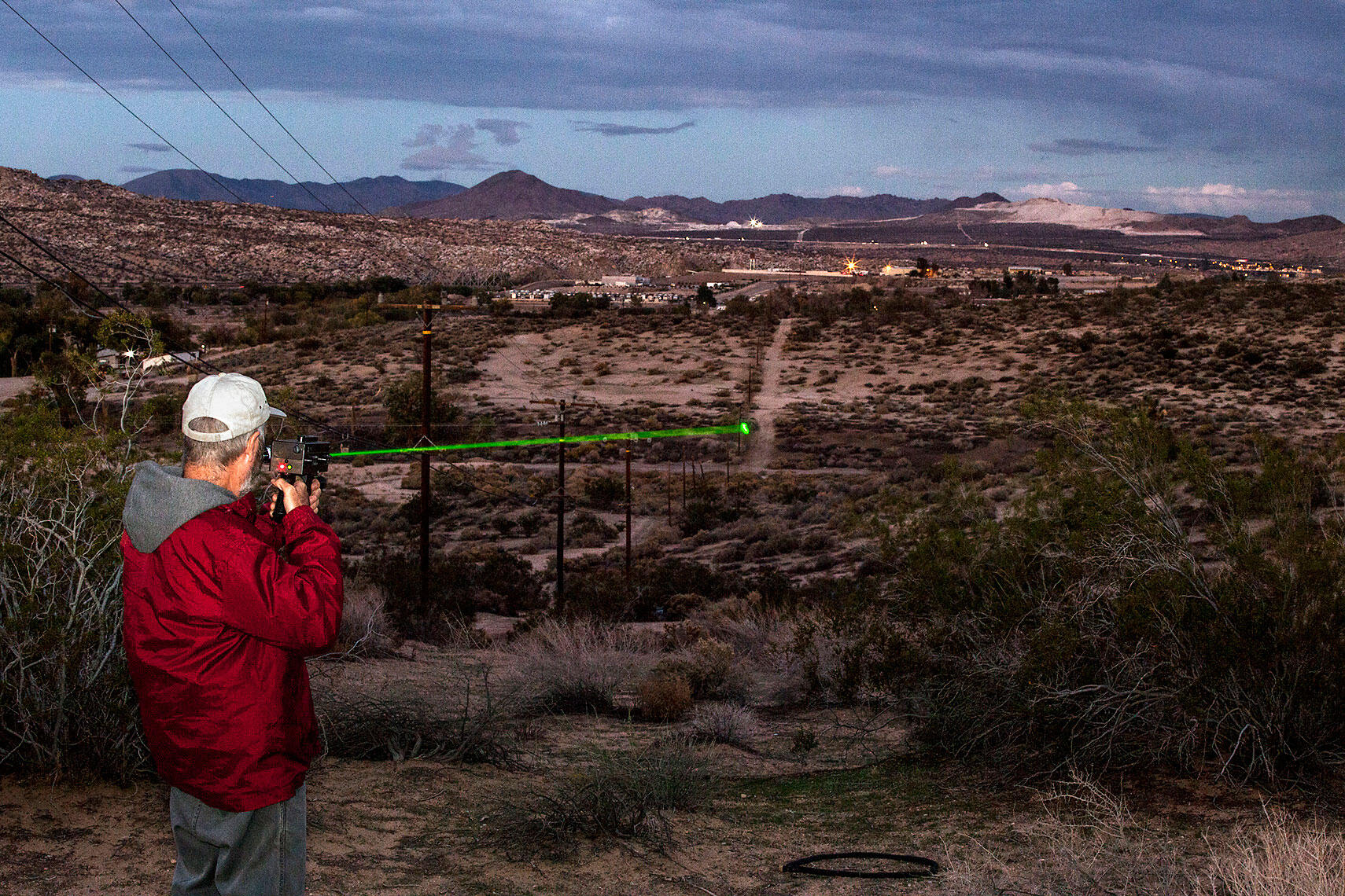 Testing a raven-repelling laser in the Mojave Desert. The beam, which doesn't harm its targets, has a range of roughly a mile. Tom Fowlks
