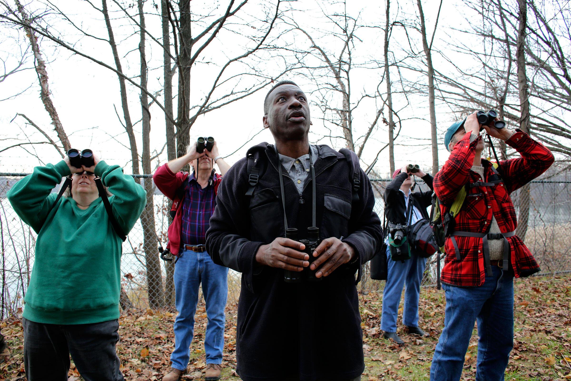 Keith Russell, program manager for Urban Conservation, Audubon Pennsylvania, center, leads a tour of the East Park Reservoir in the Strawberry Mansion section of Philadelphia on December 12, 2015. Joseph Kaczmarek