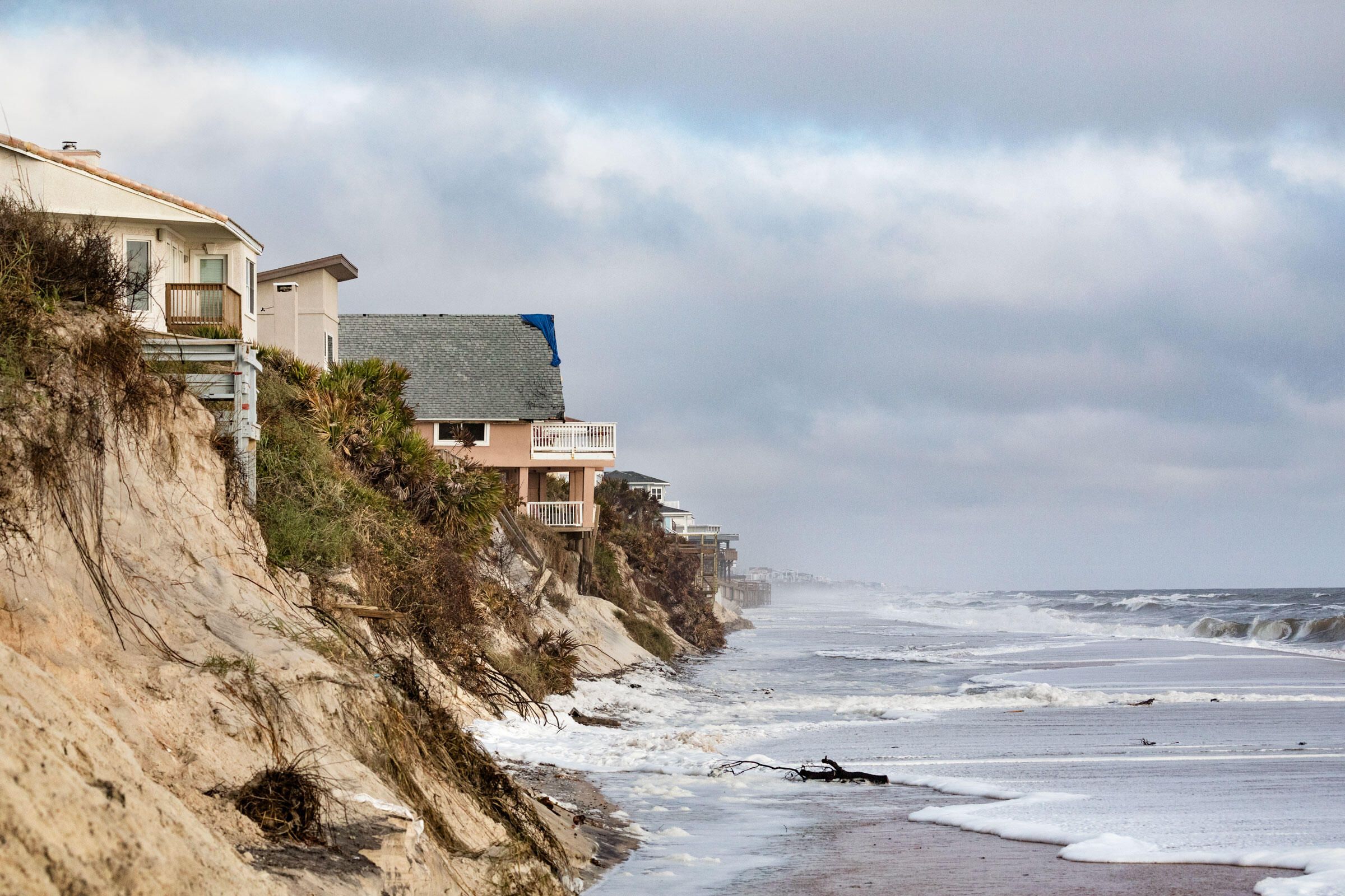 Houses on Florida's Vilano Beach built for the ocean view are now too close for comfort. A sea wall protected some parts of the beach from Hurricane Irma, but not all. Andrew Moore