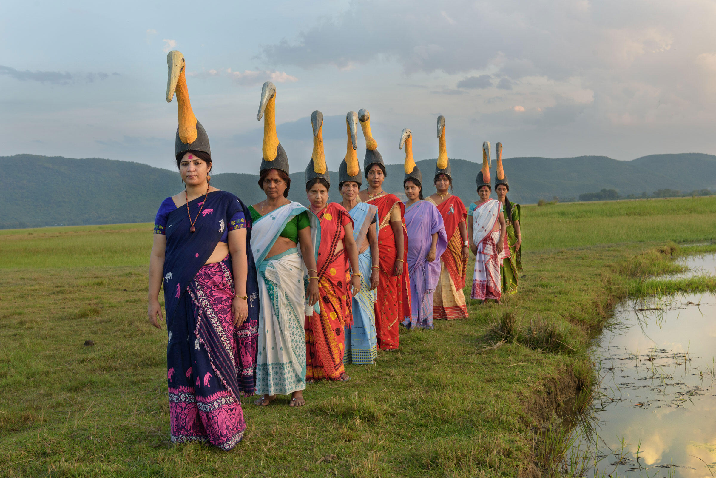 Purnima Barman (front) and women in Assam, India, sang traditional songs, adapted with stork lyrics, and danced in headdresses at a recent baby shower. Smita Sharma