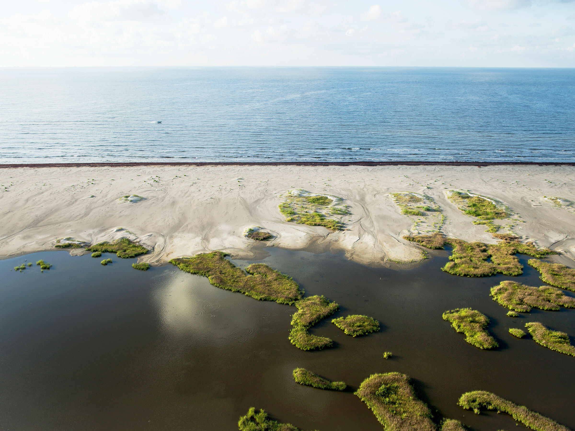 The newly restored Caminada Headland, a 13-mile-long barrier island system that buffers the Louisiana coast from tropical storms. Ben Depp