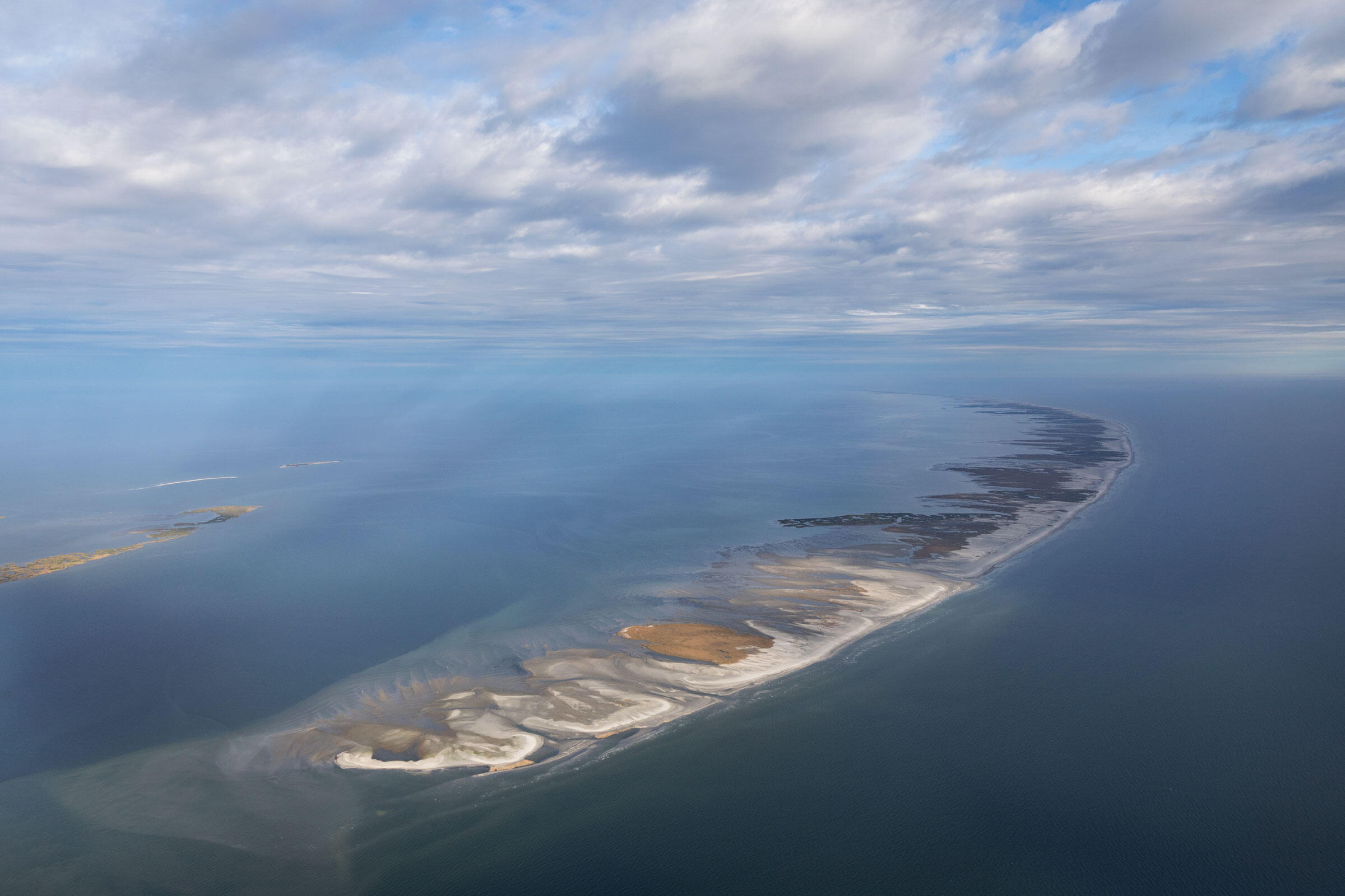 Today the powder-white beaches of Louisiana's Chandeleur Islands look pristine. Two weeks after the 2010 Deepwater Horizon explosion, oil reached these fragile shores. Mac Stone