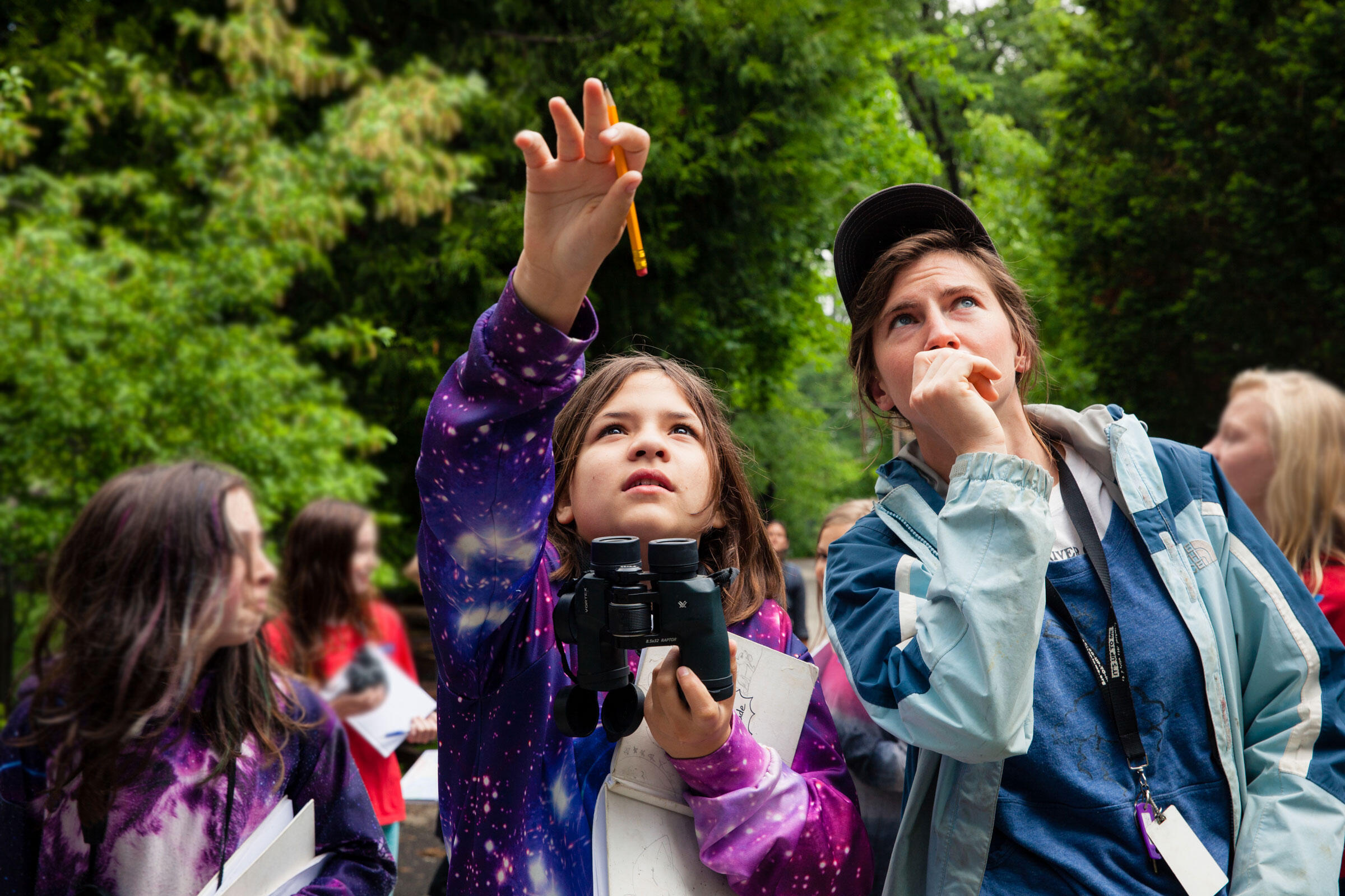 Johanna Stoermer, 12, and Emily Bryant, environmental education assistant for Plumas Audubon Society, spot a bird in a tree during a bird walk at Quincy Elementary School. Maggie Starbard