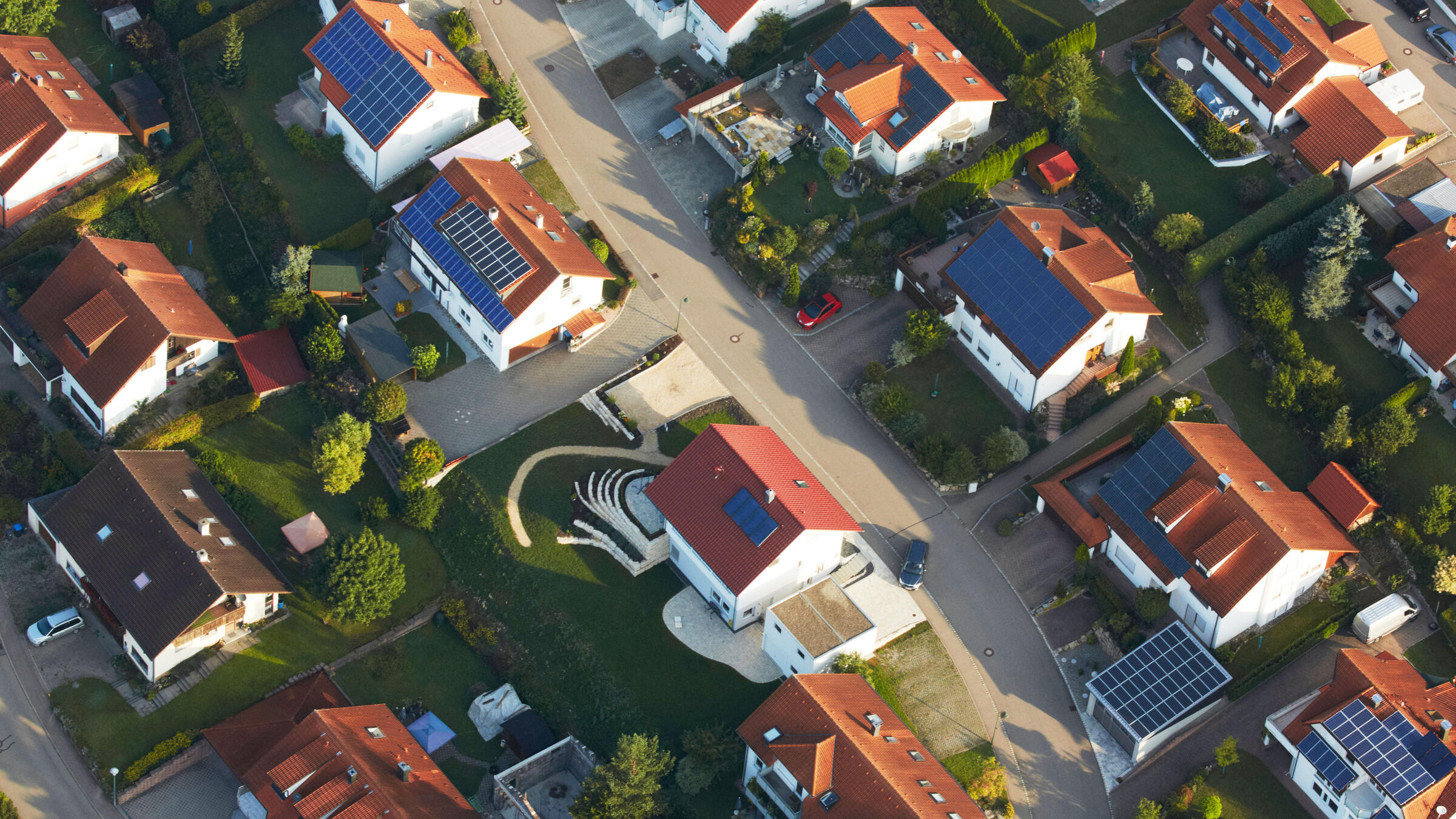 Learn more about the types and benefits of solar power, such as the rooftop panels shown on these houses in Germany. F1online digitale Bildagentur GmbH/Alamy
