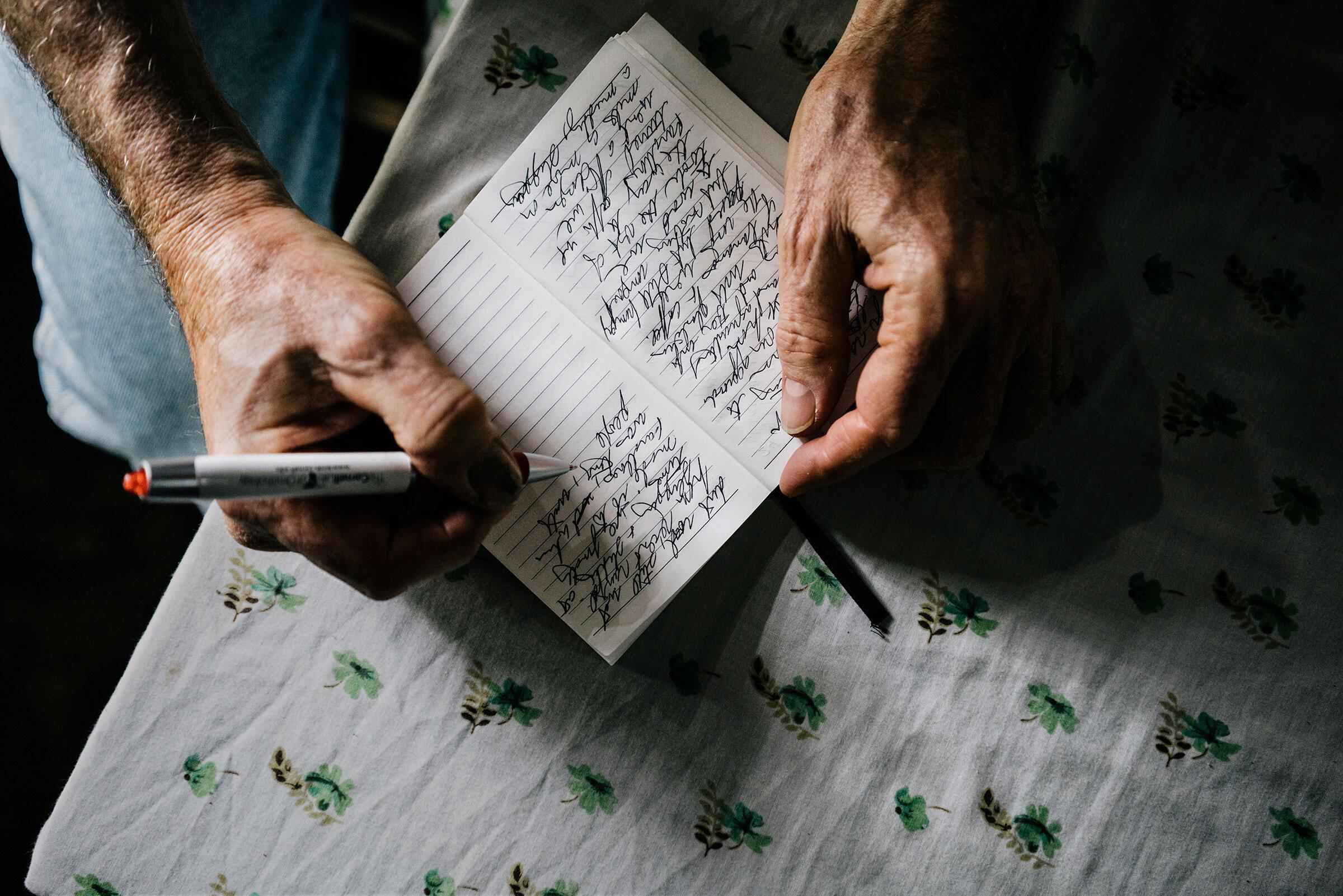 Gallagher updates his journal. Greg Kahn