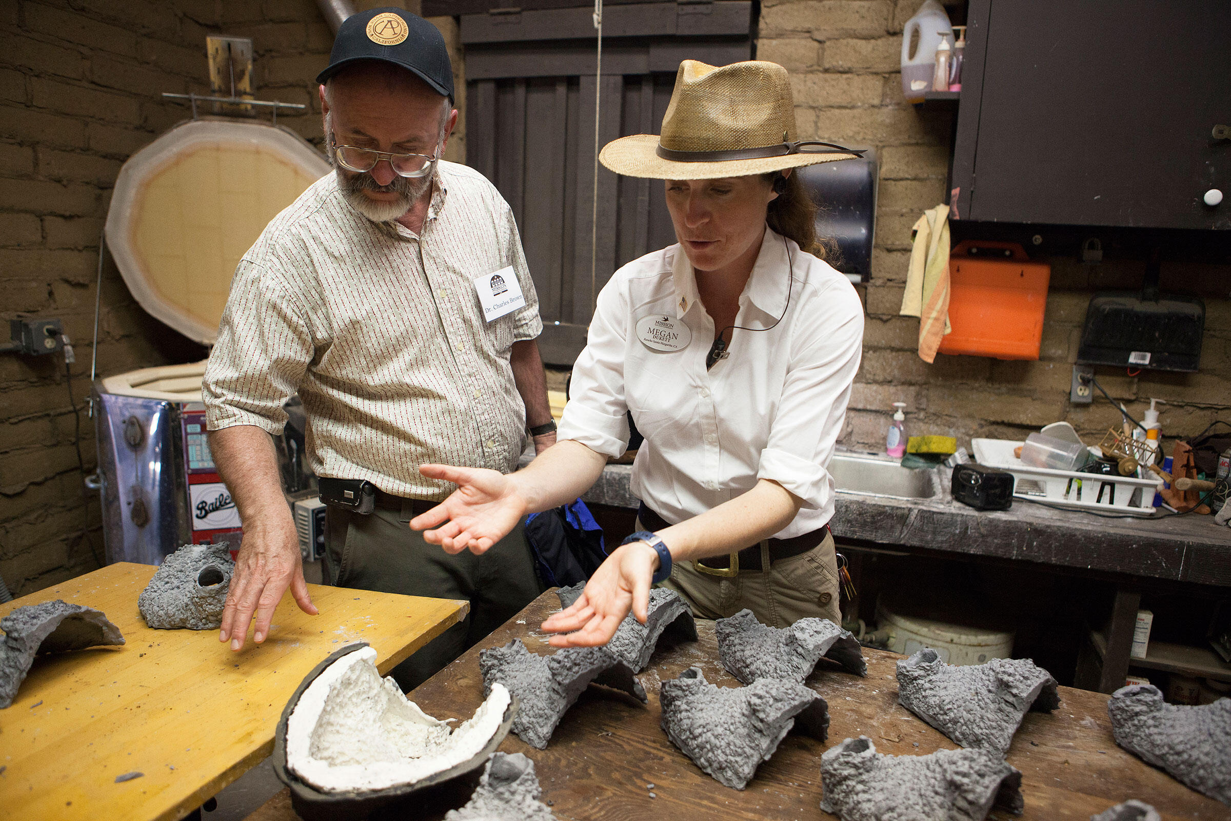 Charles Brown and Megan Dukett, the mission's education and interpretive program manager, discuss construction of the plaster nests, which were made from a mold created by one of Brown's grad students. Troy Harvey