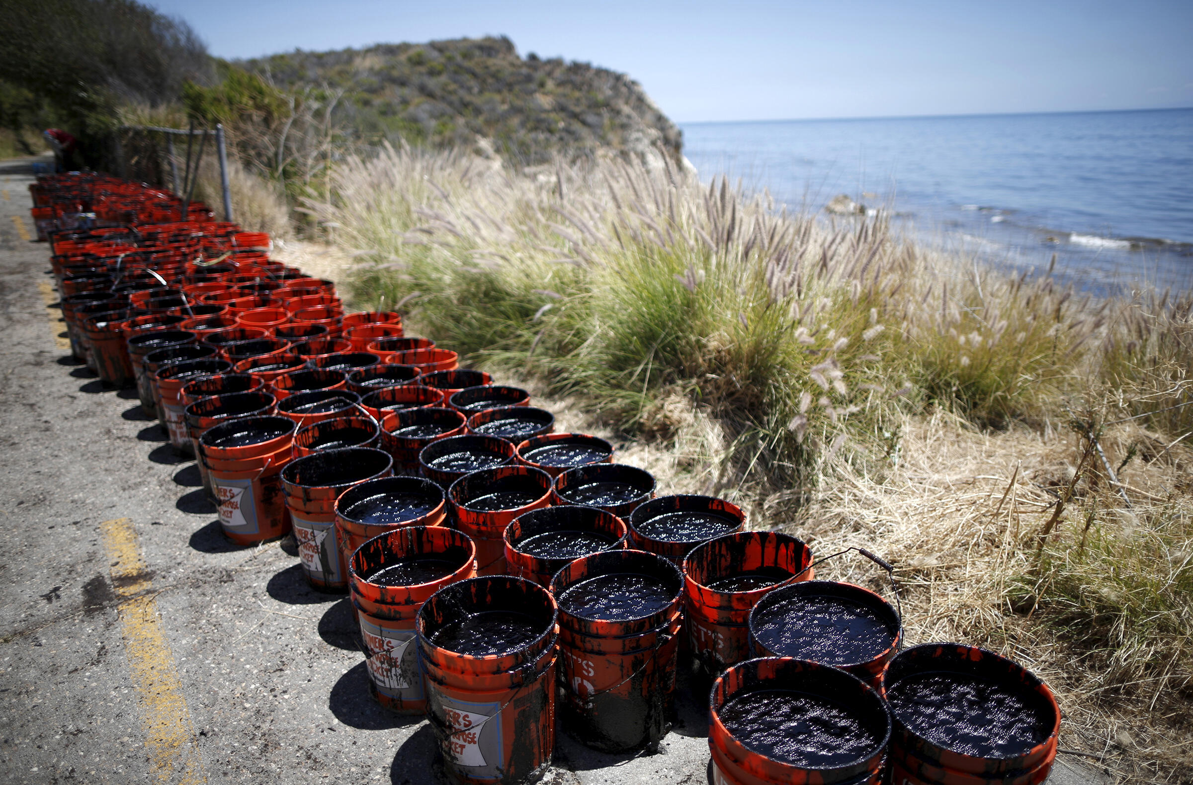 Before official cleanup crews descended on petroleum-soaked beaches, local residents scooped up thousands of gallons of crude along the coast of Refugio State Beach in Goleta, California. Lucy Nicholson/Reuters