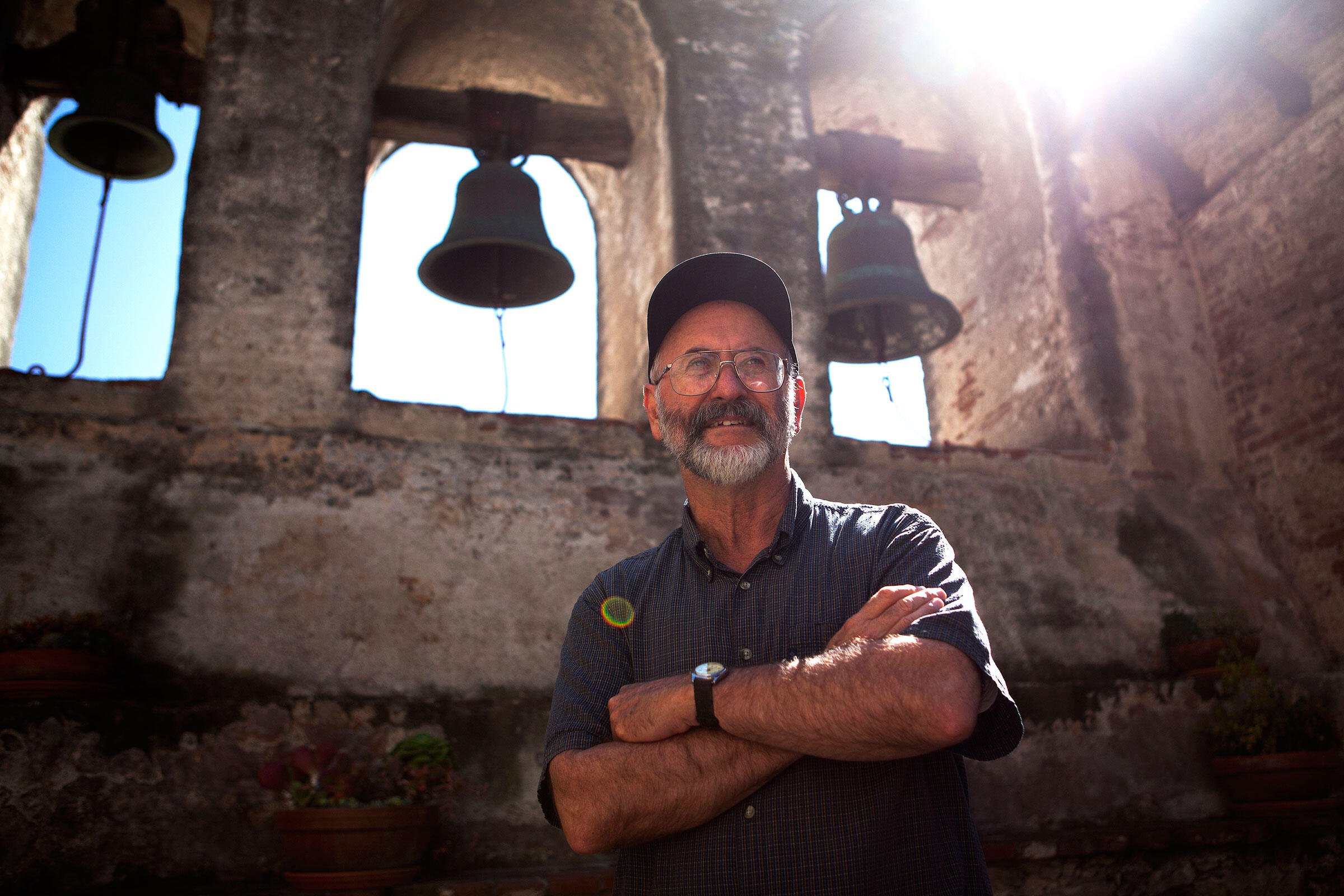 Ornithologist Charles Brown, of the University of Tulsa, stands before the bells of the Mission San Juan Capistrano, which are rung during an official ceremony at the annual Festival of the Swallows. Troy Harvey