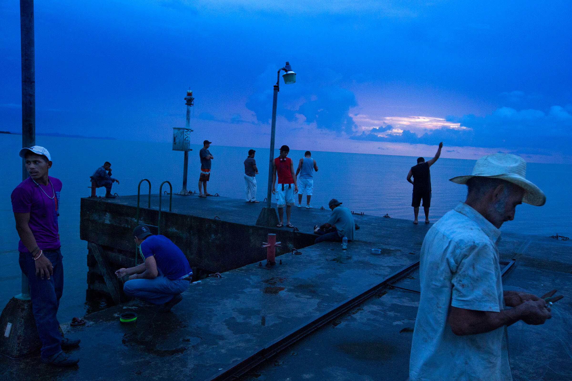 Men fish off a dock in San Miguelito, where the canal will enter Lake Nicaragua on its eastern shore. Ivan Kashinsky