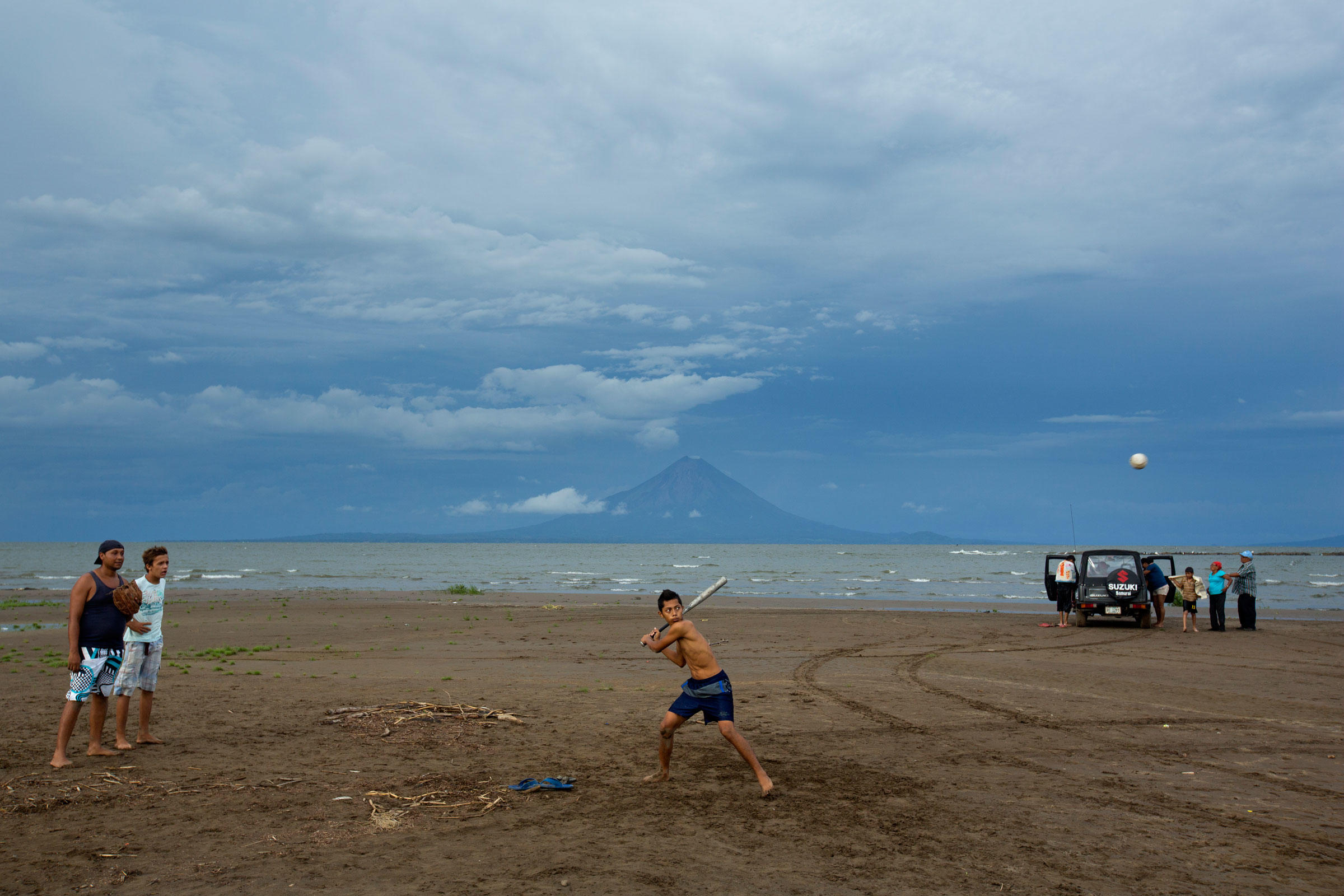 Boys from the town of Los Cocos, on the western side of Lake Nicaragua, play baseball on Playa la Virgen, which will be destroyed by the canal. Ivan Kashinsky