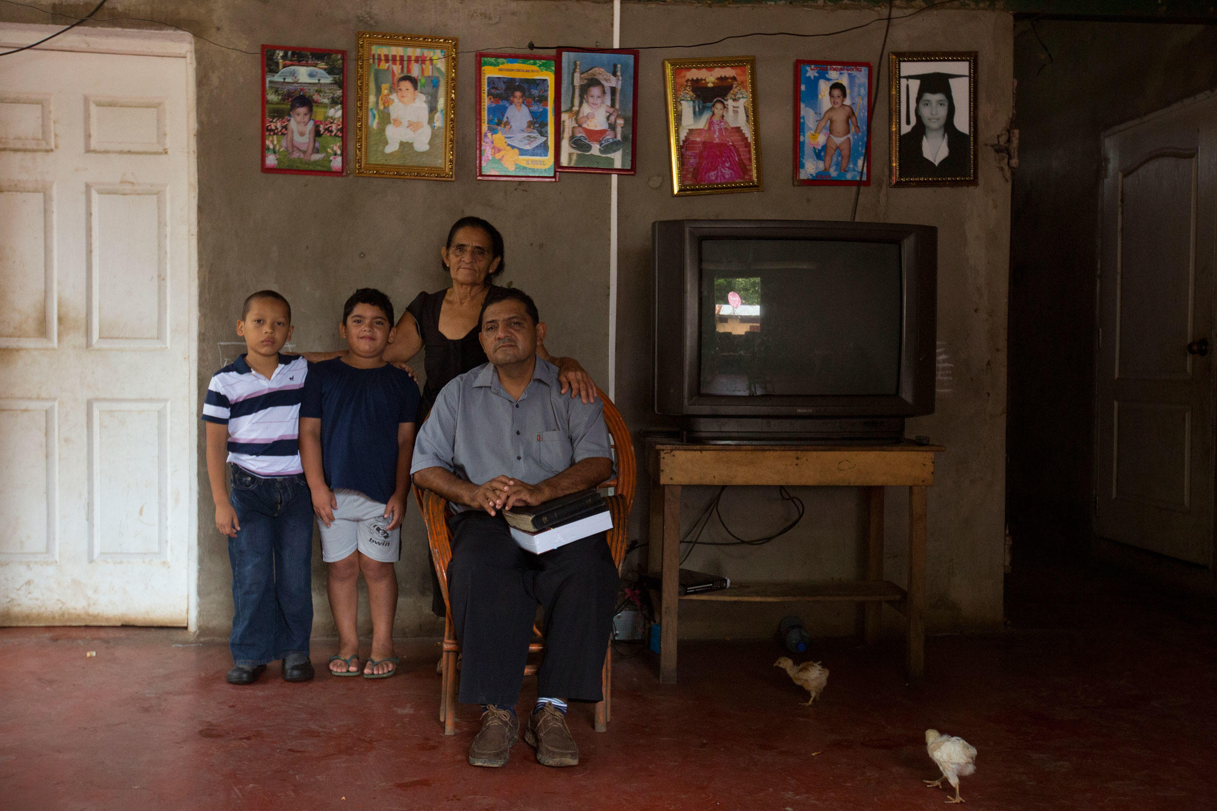 Pastor Eduardo Cortez at home with his grandsons and mother in Tola, Nicaragua, not far from where the canal will connect to the Pacific Ocean. Ivan Kashinsky