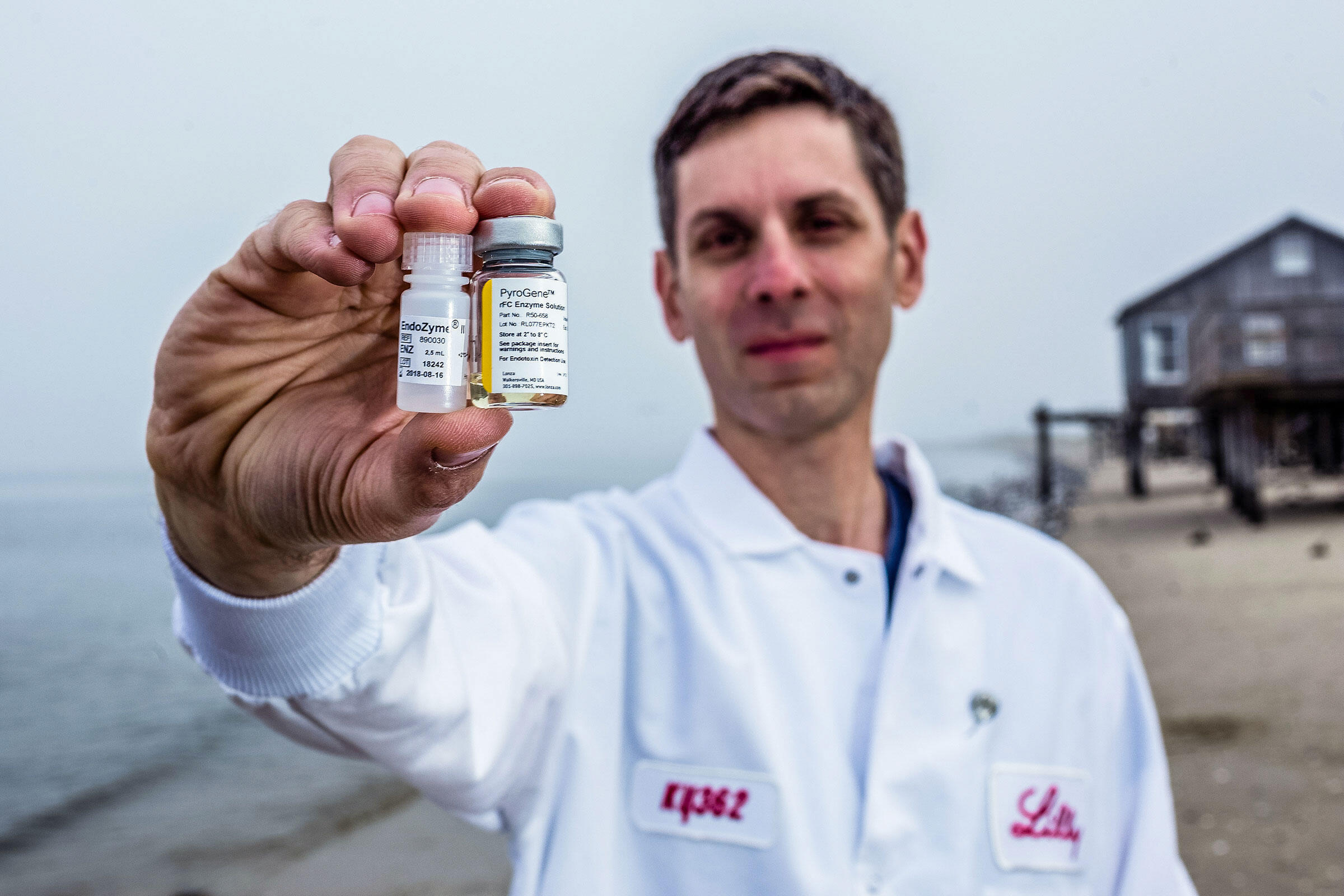 Jay Bolden holds two vials of rFC—one from each of two manufacturers. Thanks to his perseverance, Eli Lilly will transition 90 percent of its endotoxin tests from LAL, which relies on bleeding horseshoe crabs, to rFC. Timothy Fadek/Redux