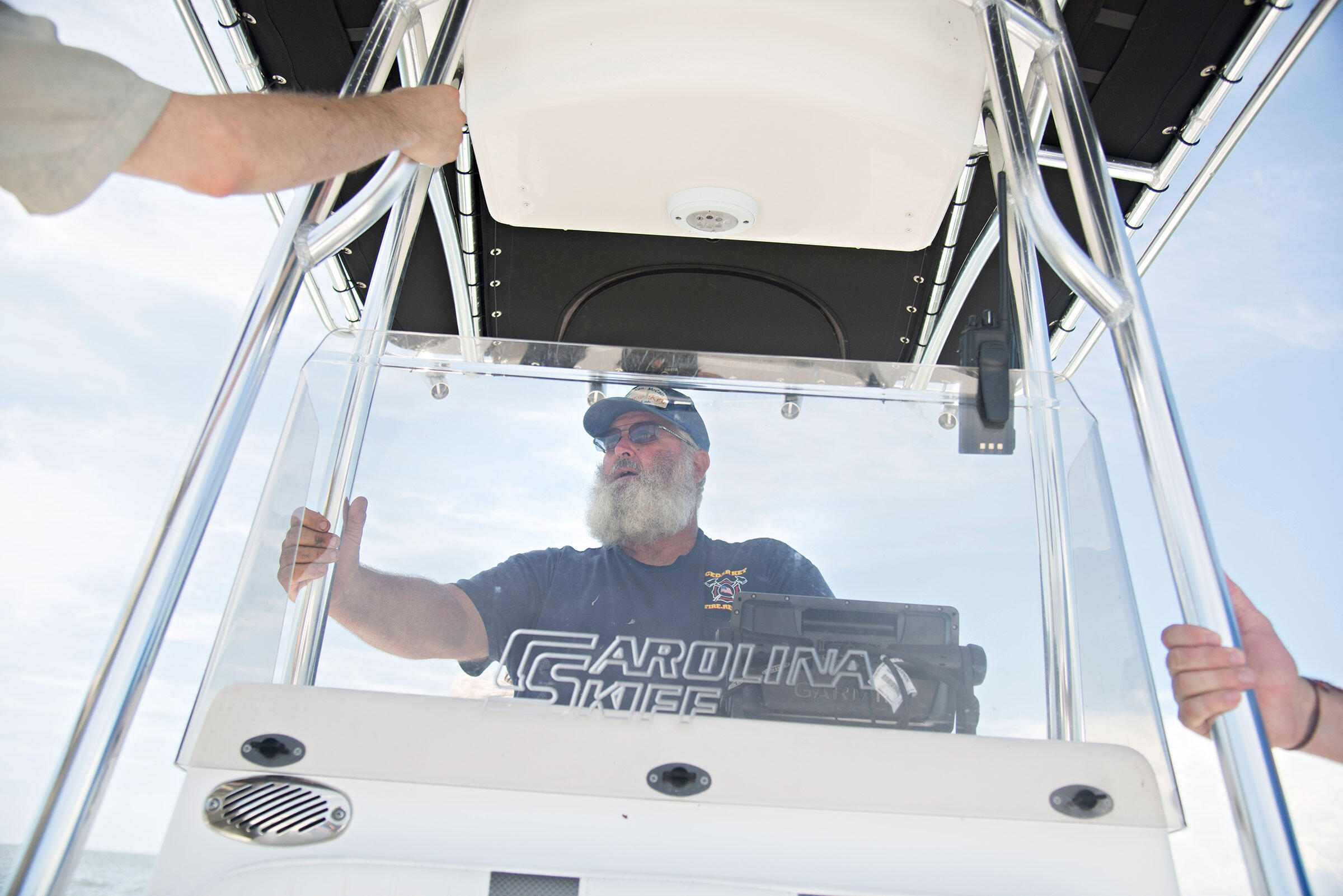 Captain Kenny McCain steers the boat across the channel from Cedar Key to Seahorse Key. Melissa Lyttle